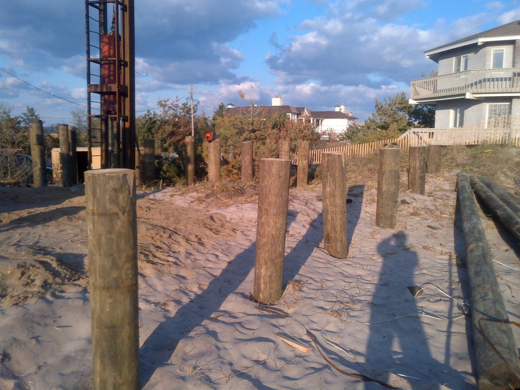 View of machine pile driving the wooden piers