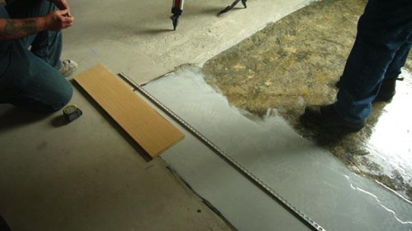 Step 4  - Setting elevation relative to adjacent wood flooring and aluminum trim angle