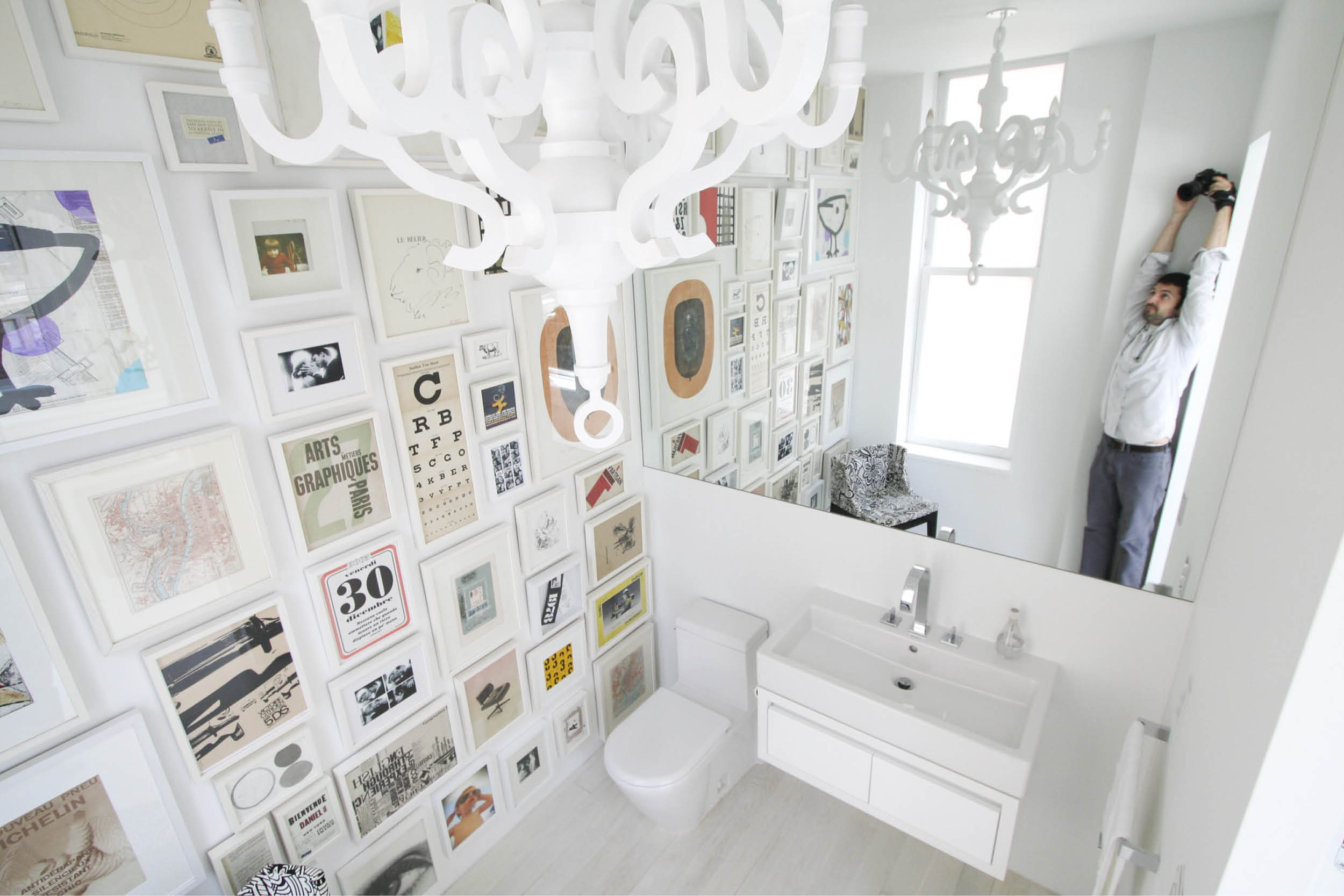 Modern New York City Union Square Loft Renovation | White Powder Room Bathroom with Art | RES4