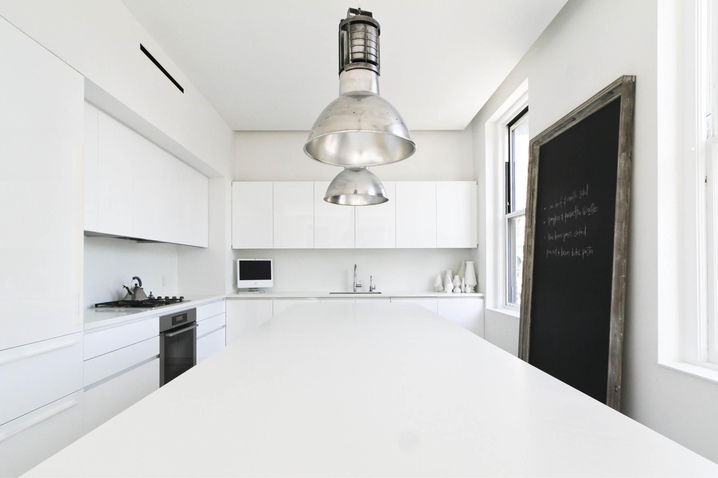 Modern New York City Union Square Loft Renovation | White Kitchen Island Custom Cabinets | RES4