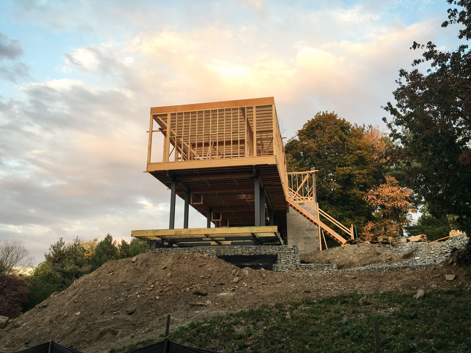 Exterior Perspective  - A view of the end of the House, Pool Deck, and Gabion Retaining Wall
