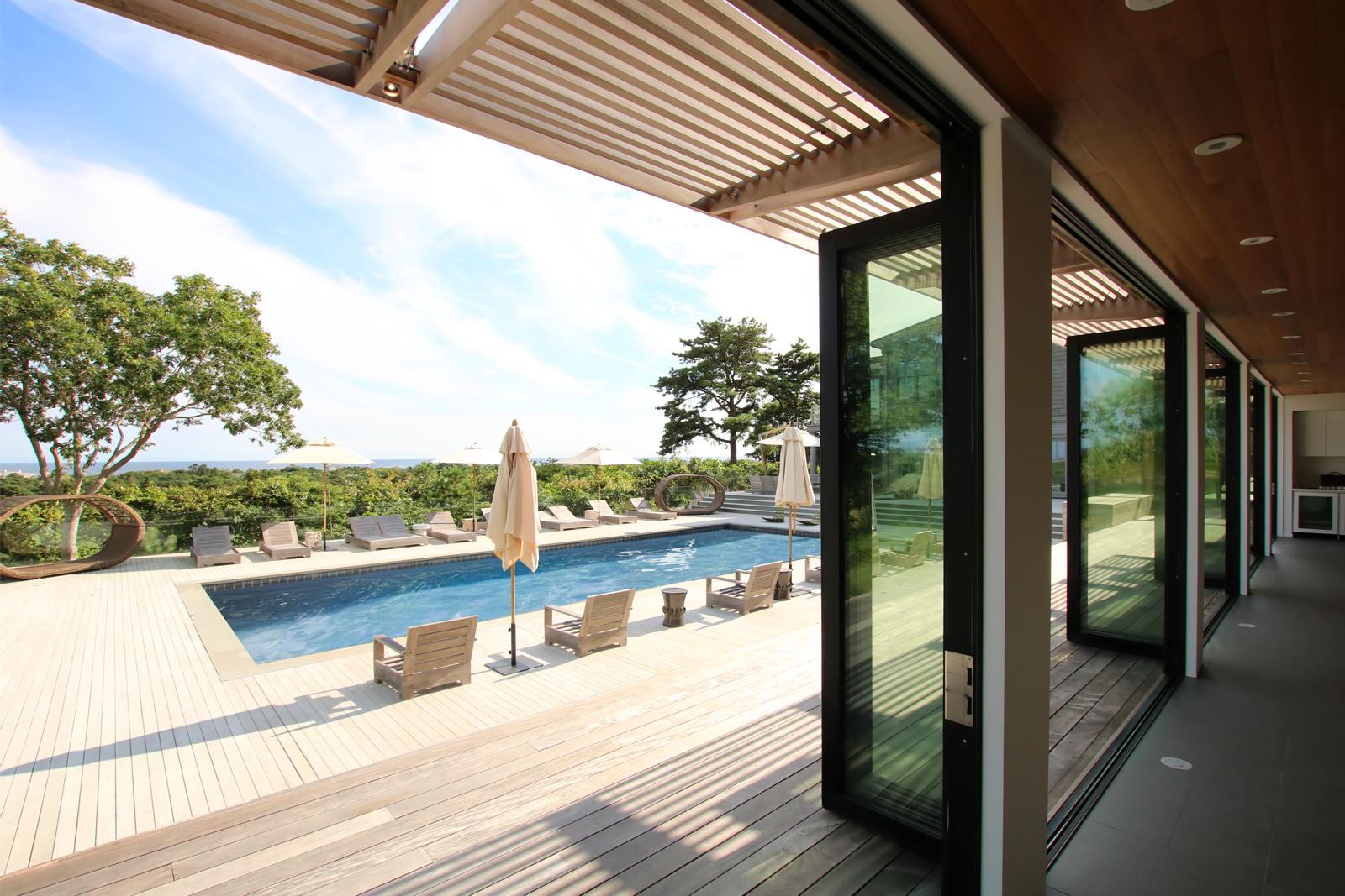 res4-resolution-4-architecture-modern-modular-house-prefab-amagansett-addition-exterior-pool-deck-terrace.jpg