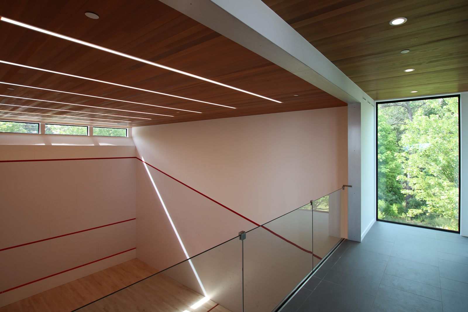 res4-resolution-4-architecture-modern-modular-house-prefab-amagansett-addition-interior-gym-lighting.jpg