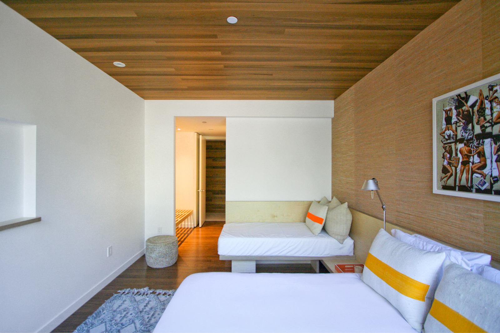 res4-resolution-4-architecture-modern-modular-house-prefab-amagansett-addition-bedroom-perspective-02.jpg