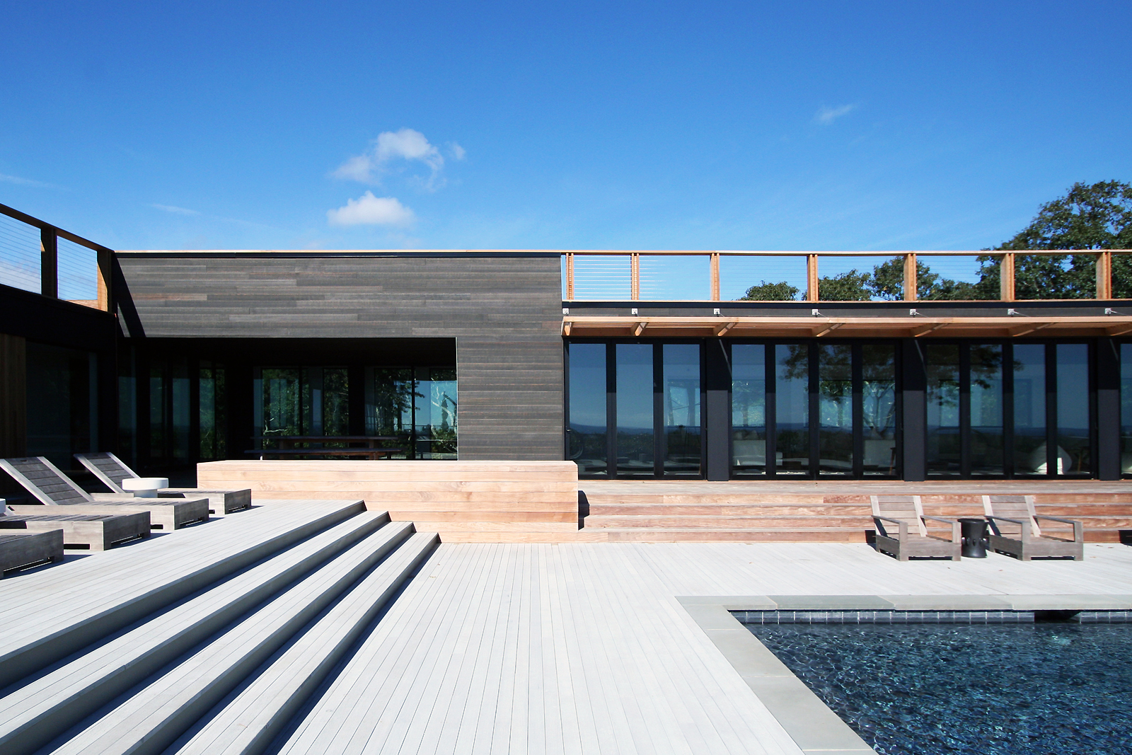 res4-resolution-4-architecture-modern-modular-house-prefab-amagansett-addition-exterior-facade-pool-deck-terrace.jpg