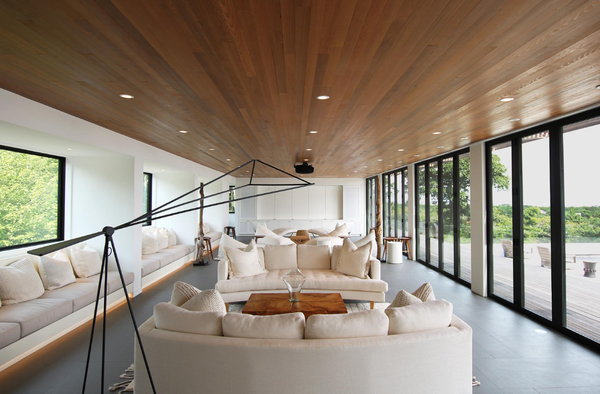 res4-resolution-4-architecture-modern-modular-house-prefab-amagansett-addition-interior-living-room-lounge.jpeg