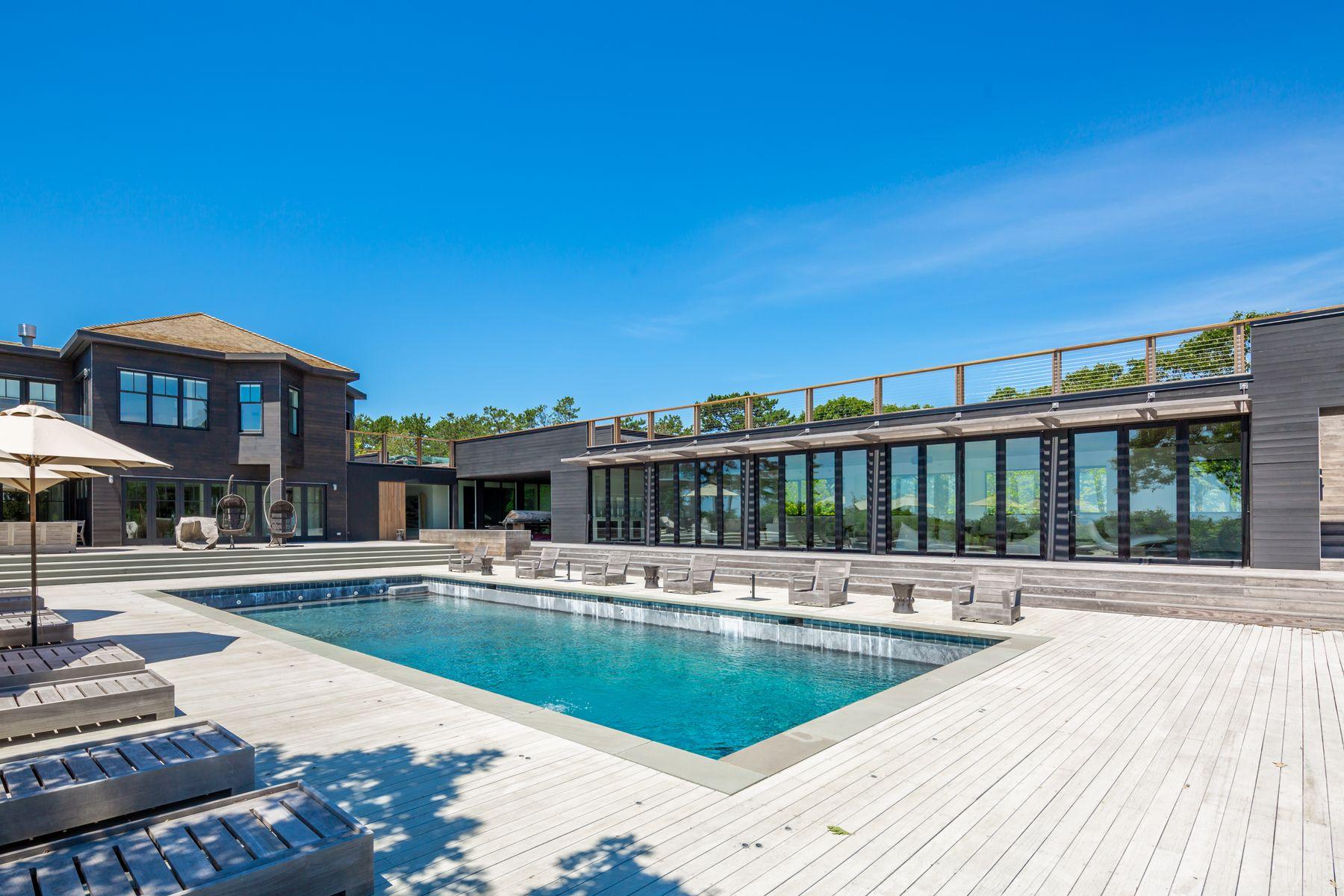 res4-resolution-4-architecture-modern-modular-house-prefab-amagansett-addition-exterior-lounge-pool-deck-trellis-shade.jpg
