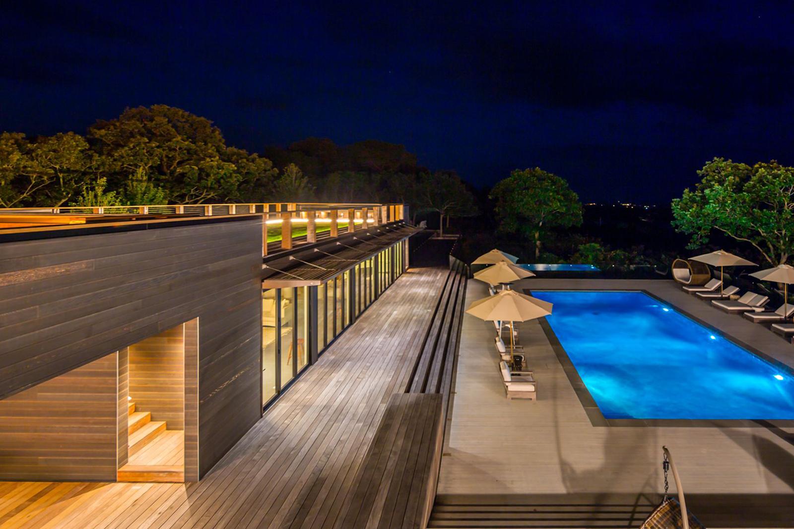 17-res4-resolution-4-architecture-modern-modular-house-prefab-amagansett-addition-exterior-lounge-pool-night.jpg