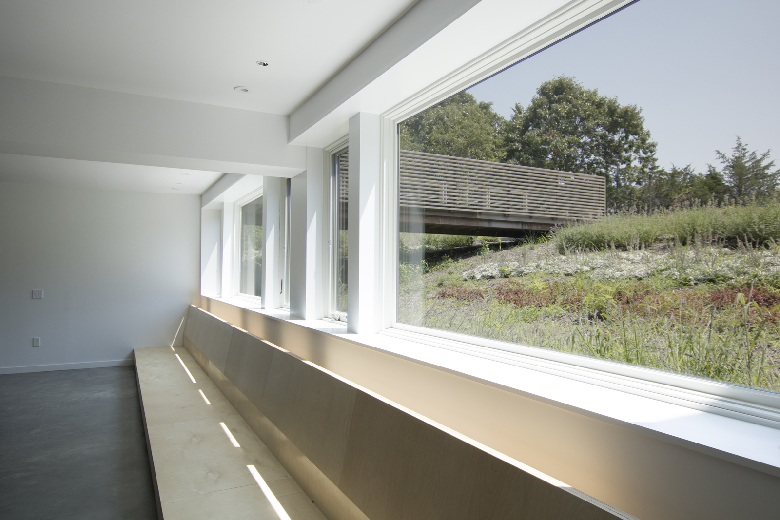 18-res4-resolution-4-architecture-modern-modular-house-prefab-home-north-fork-bluff-house-interior-basement.jpg
