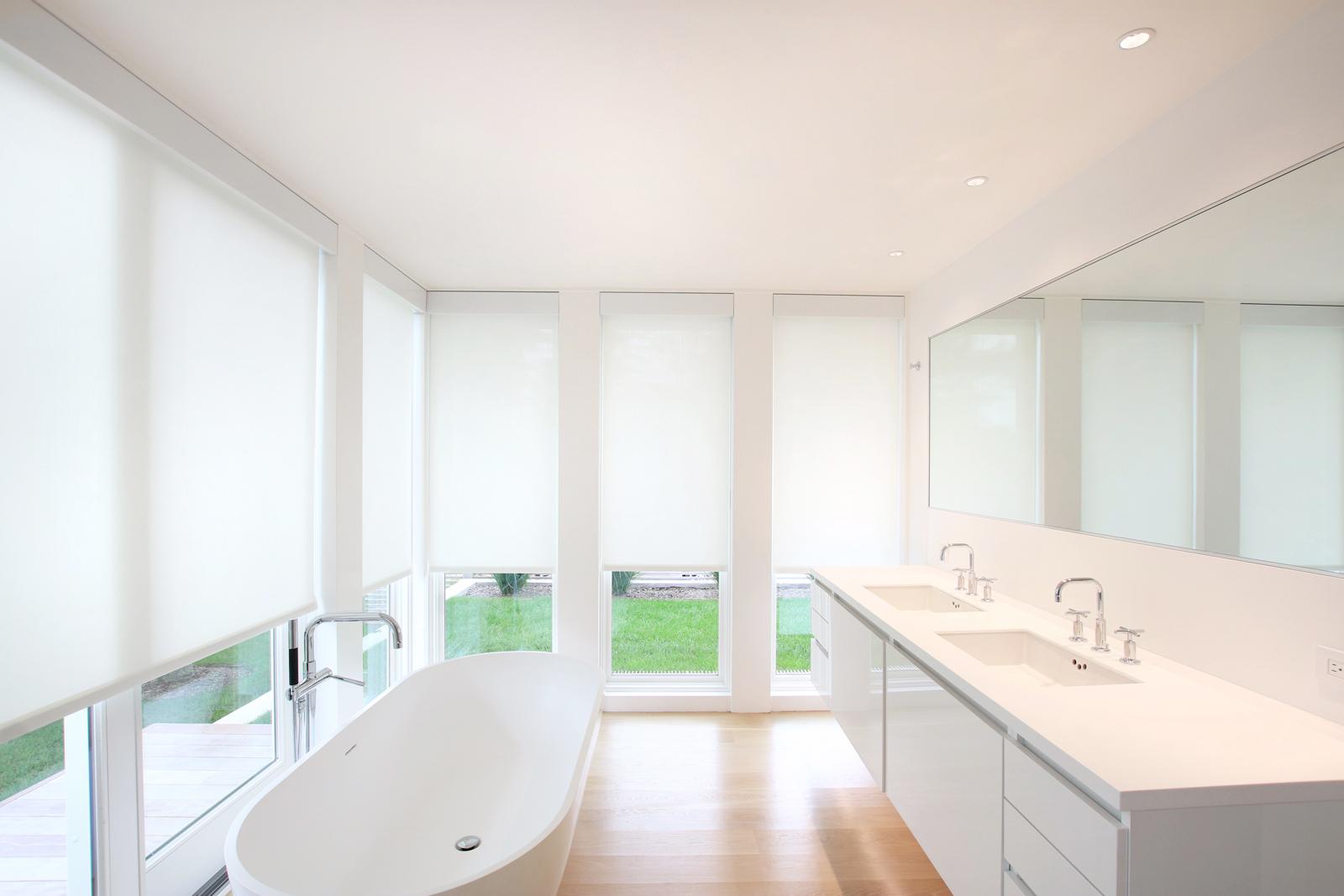 18-re4a-resolution-4-architecture-modern-modular-prefab-bridgehampton house-interior-master-bath-room-shades-closed.jpg