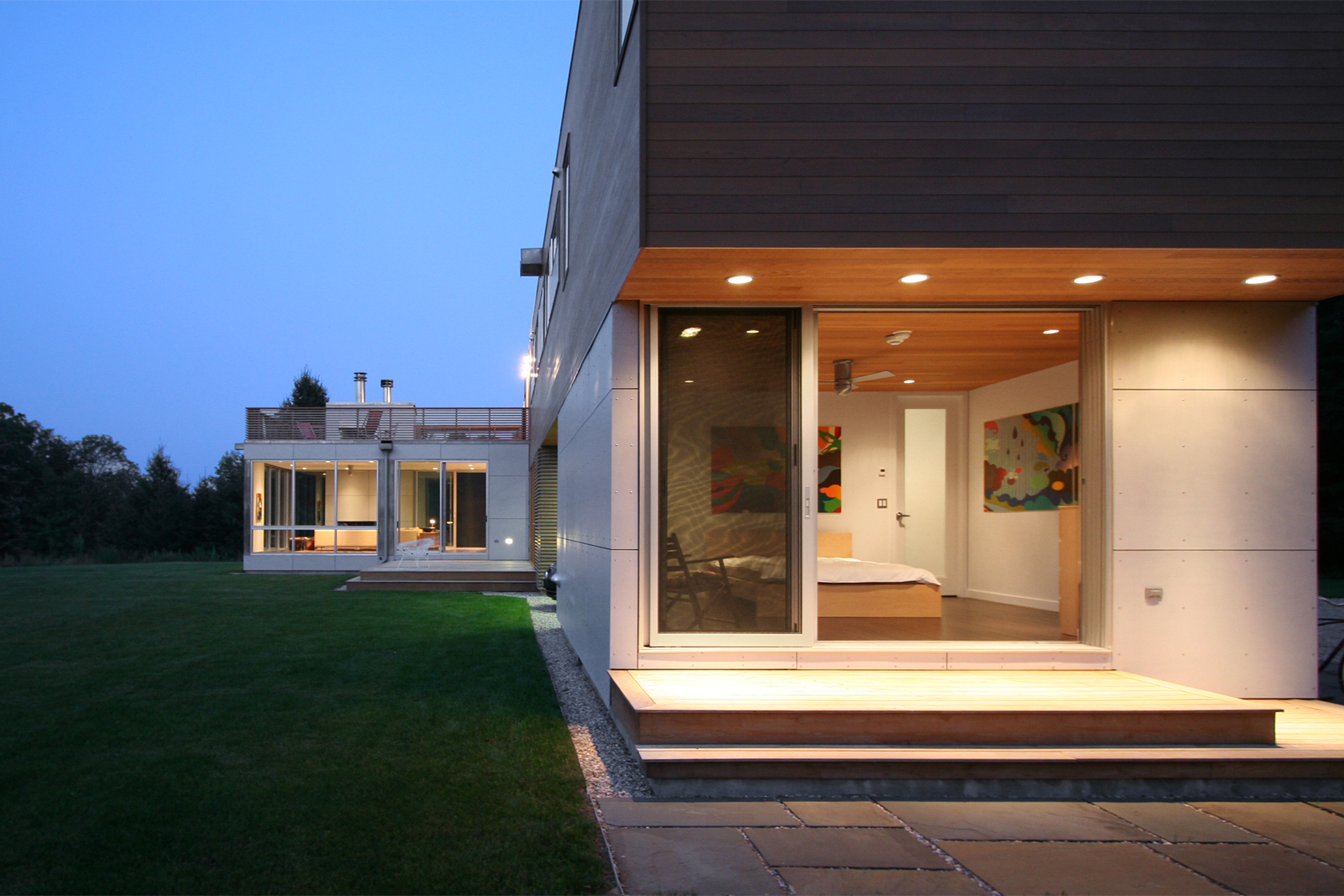 18-res4-resolution-4-architecture-modern-modular-home-prefab-sunset-ridge-house-exterior-dusk.jpg