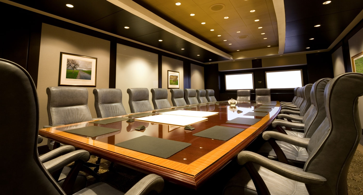 Full-feature boardroom with video conferencing, presentation systems and control systems.