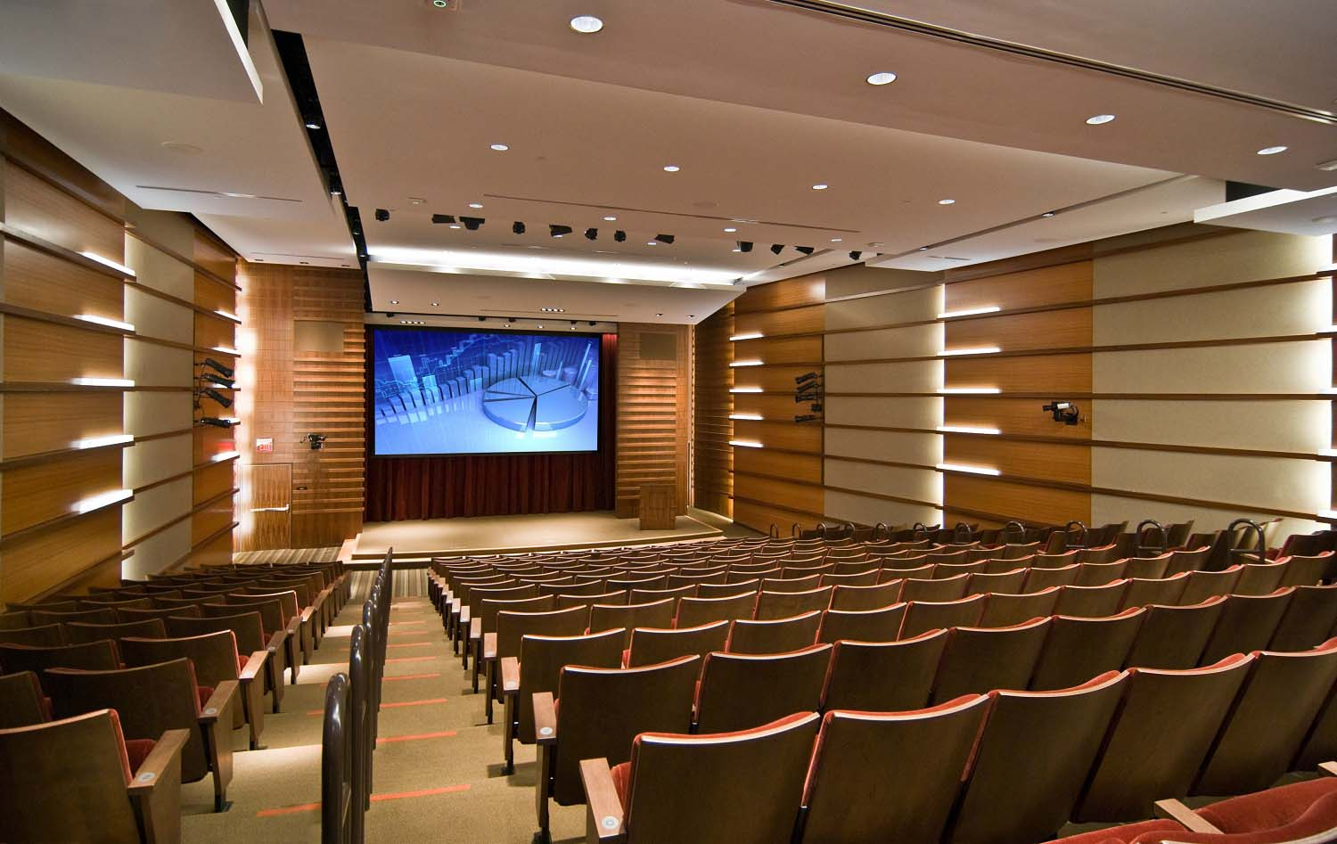 Large meeting spaces such as this auditorium use projection systems instead of a seried of display panels.