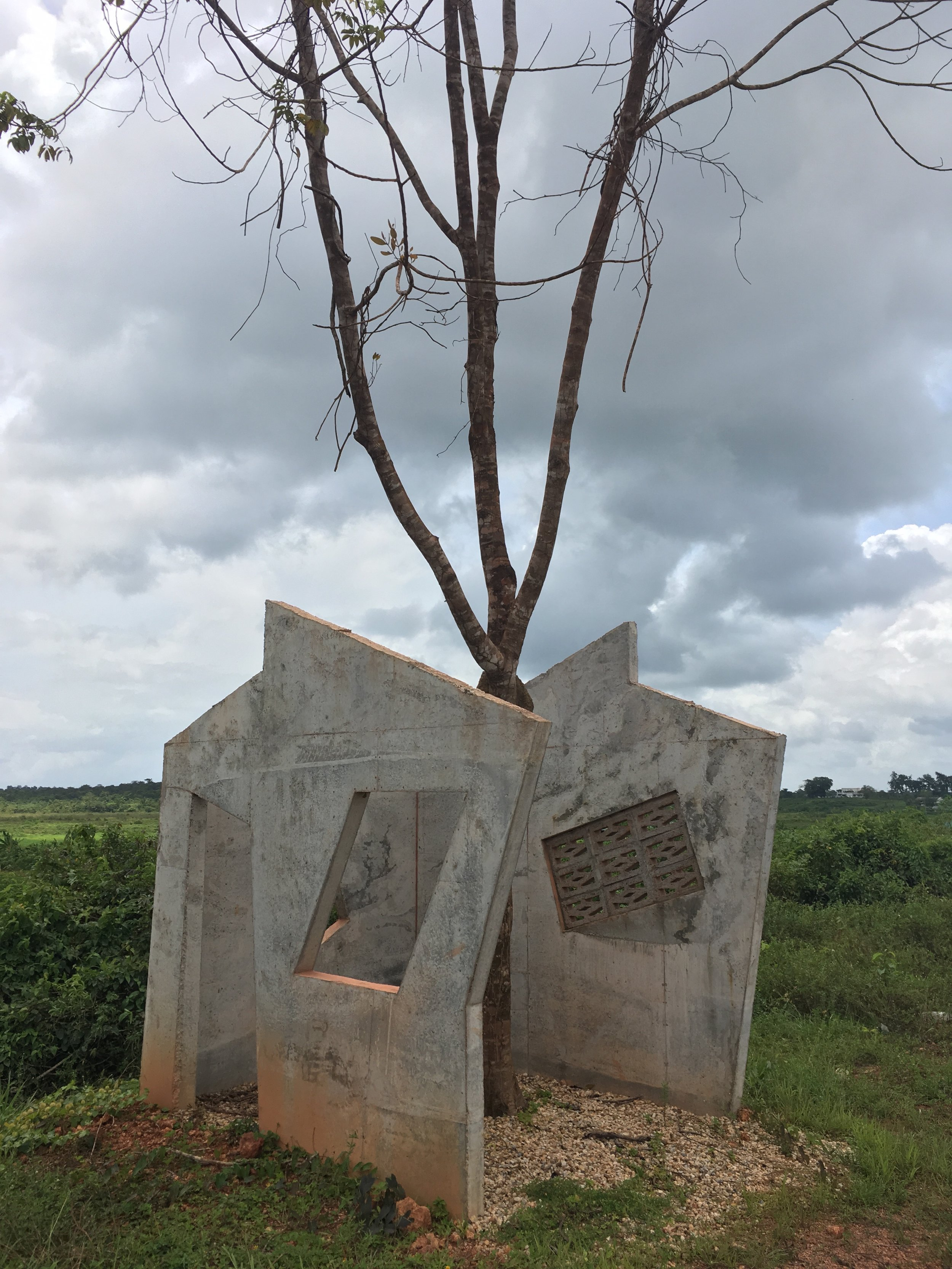 Dutch artist Feiko Becker's  Afu-Osu  (half-house in Ndyuka) was a part of the artist's broader reflection on failure. He noticed many unfinished houses in Moengo and thought these were failed projects. When he later discovered that it often takes as long as ten years to build a house in Suriname, he realised that what he was observing was not failure, but rather a long process of becoming.