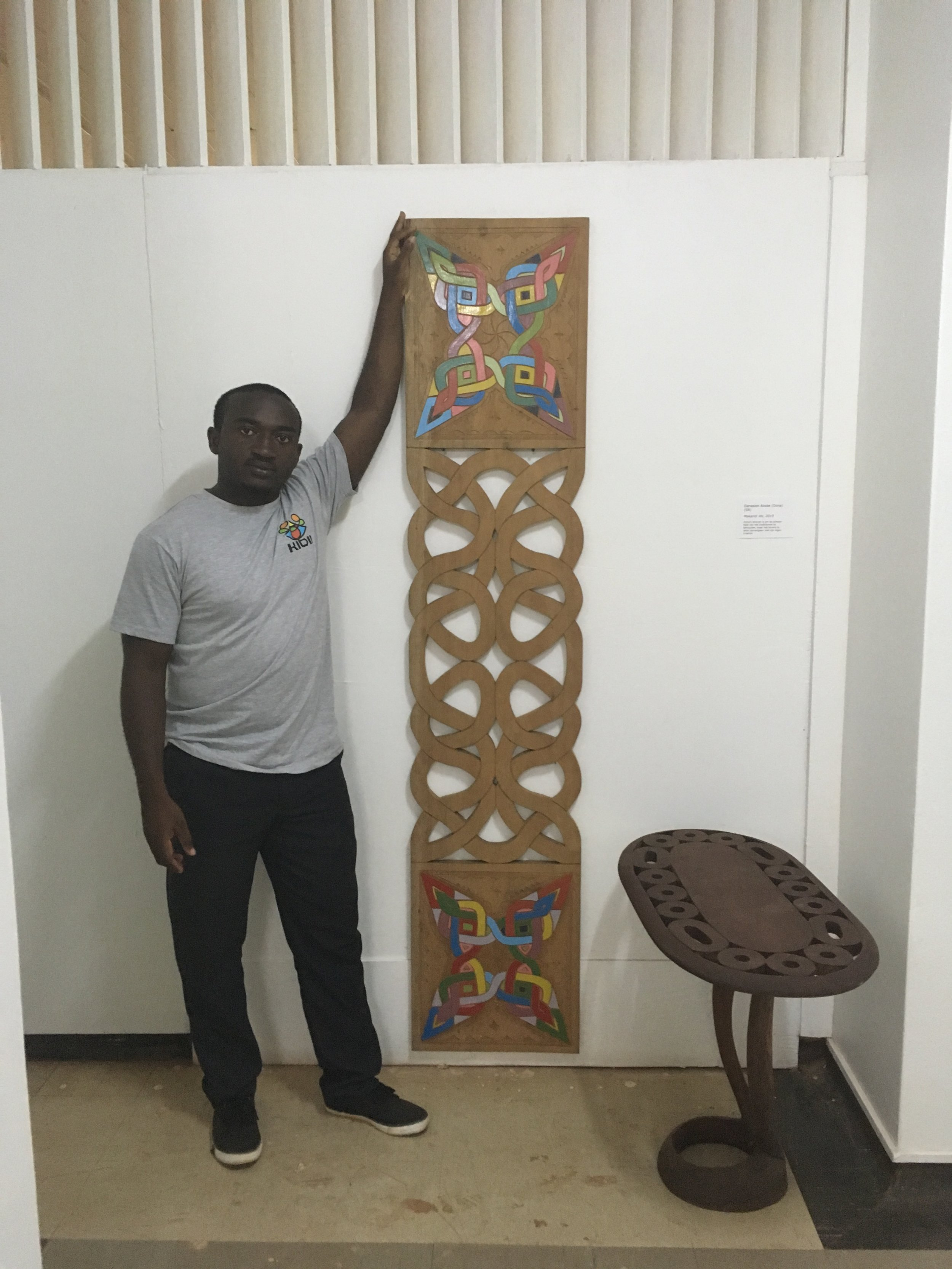 Inside CAMM: Wadell Akobe with tembe (traditional Maroon art) made by him and his father, Dona Akobe.