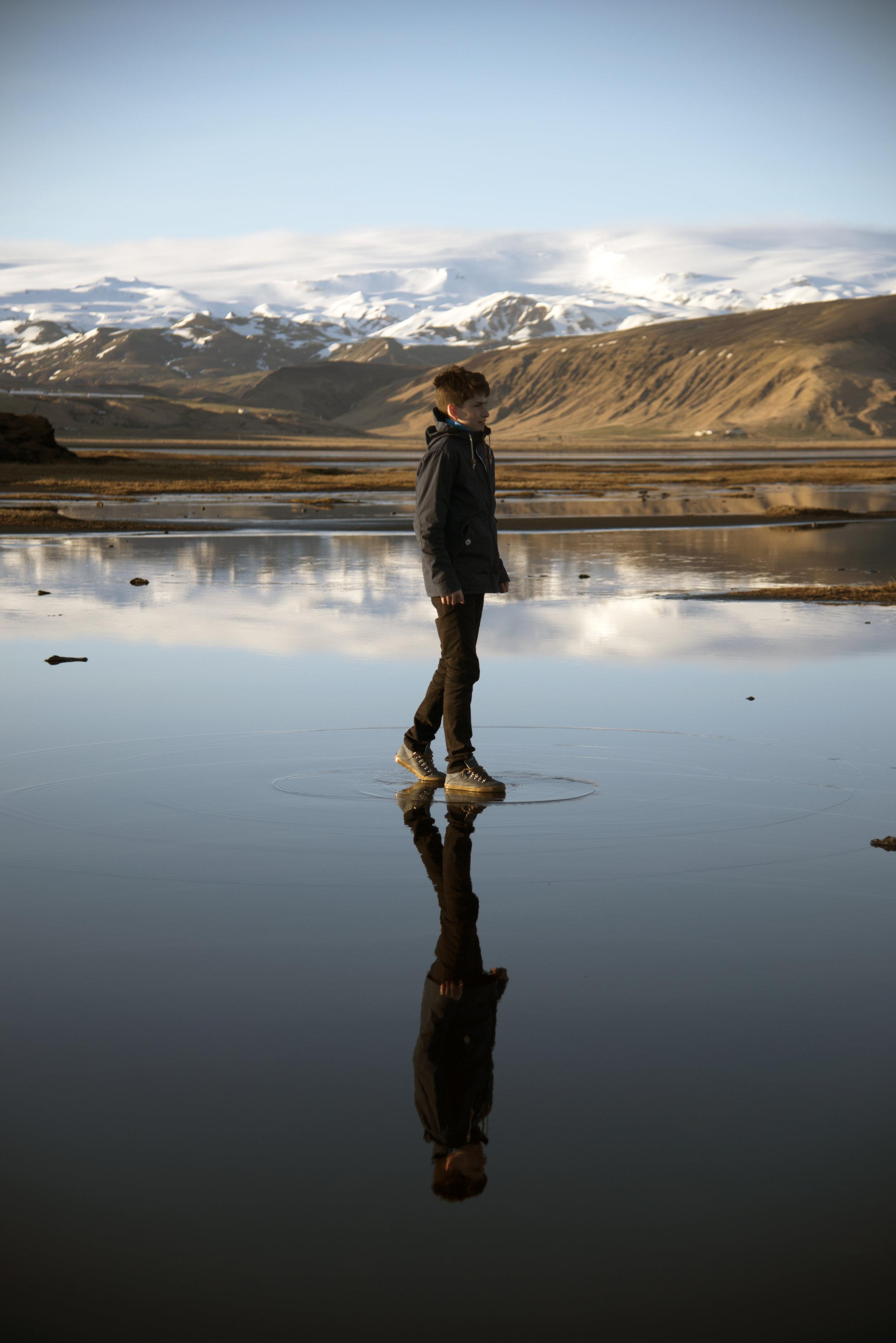 Joe Standing on Reflection in Iceland.jpg