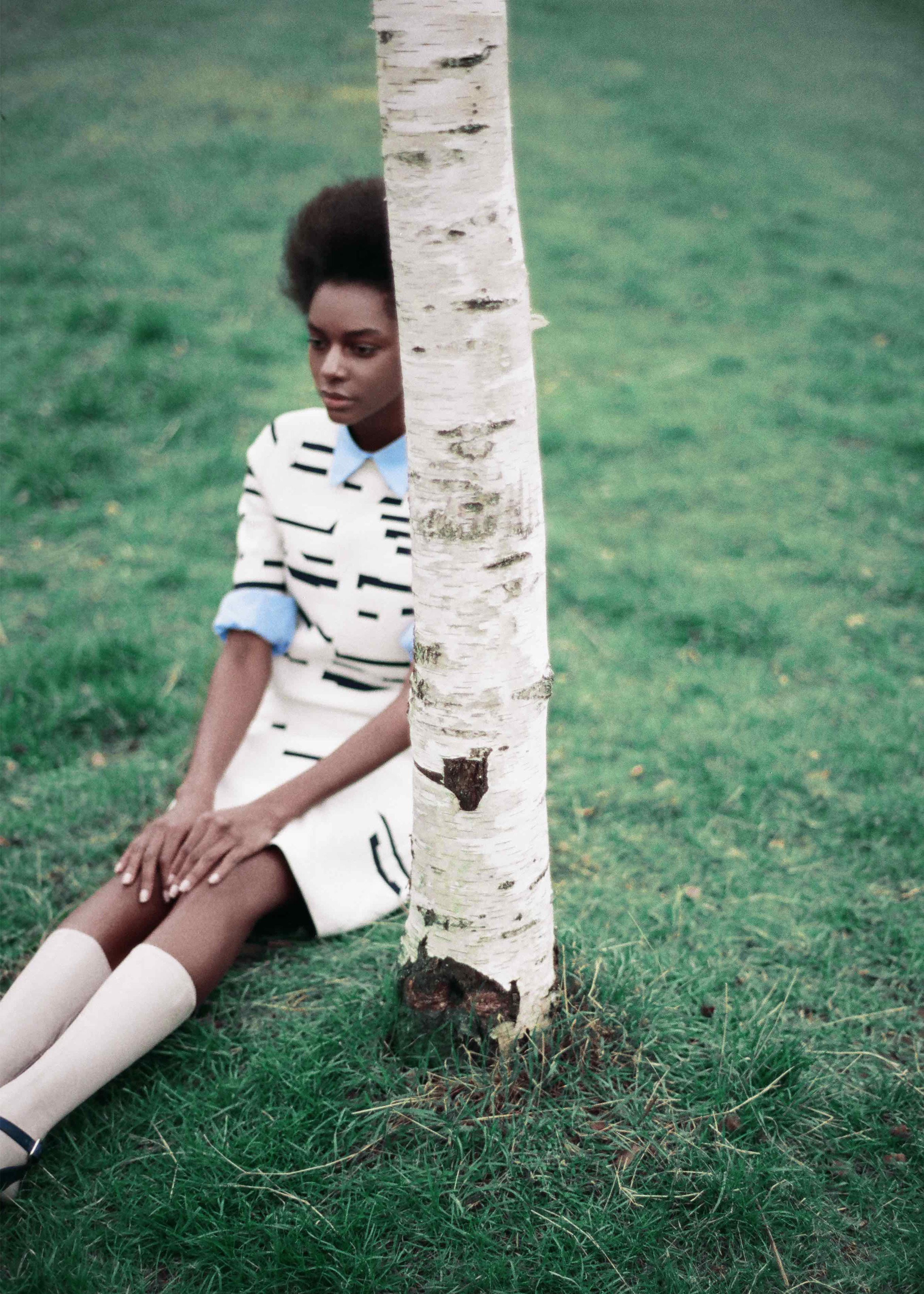 Short sleeved jacquard sweater and skirt, blue cotton poplin shirt, calf leather socks and sandals.
