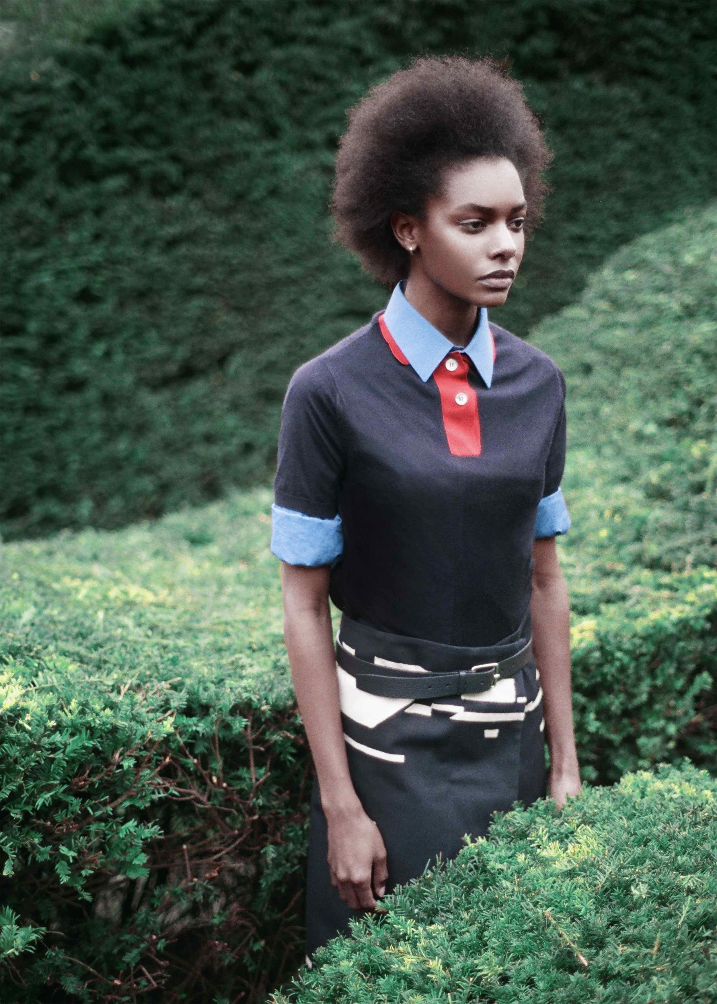 Navy cashmere polo, blue cotton poplin shirt, jacquard navy skirt, calf leather belt.