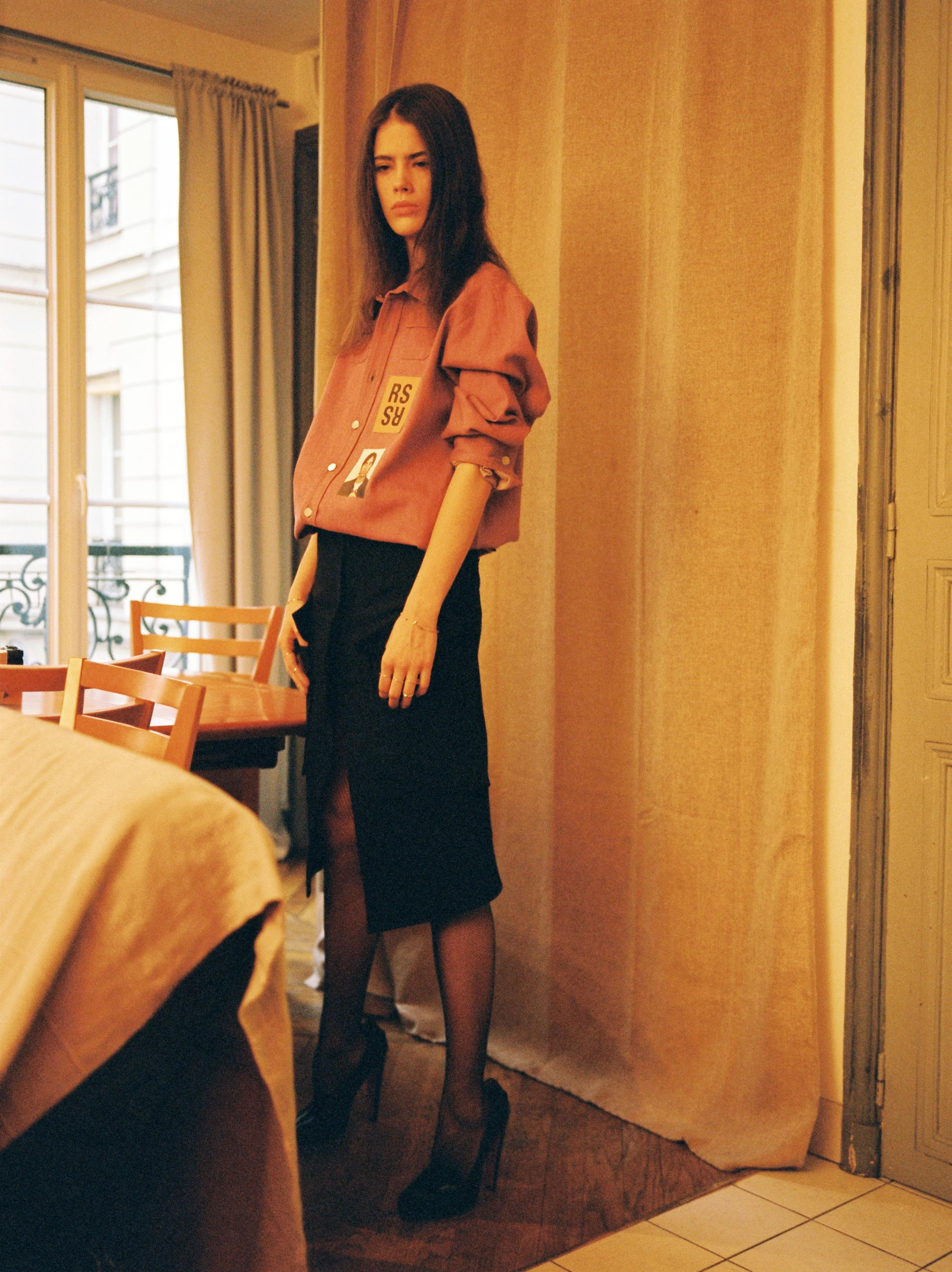 Logo patch workwear shirt  RAF SIMONS,  wool pencil skirt  ACNE STUDIOS,  tights  WOLFORD,  black leather heeled loafers  CHRISTIAN LOUBOUTIN for OLYMPIA LE-TAN,  fine silver rings  LAURA LEE JEWELLERY,  diamond bracelets  SWEET PEA JEWELLERY .