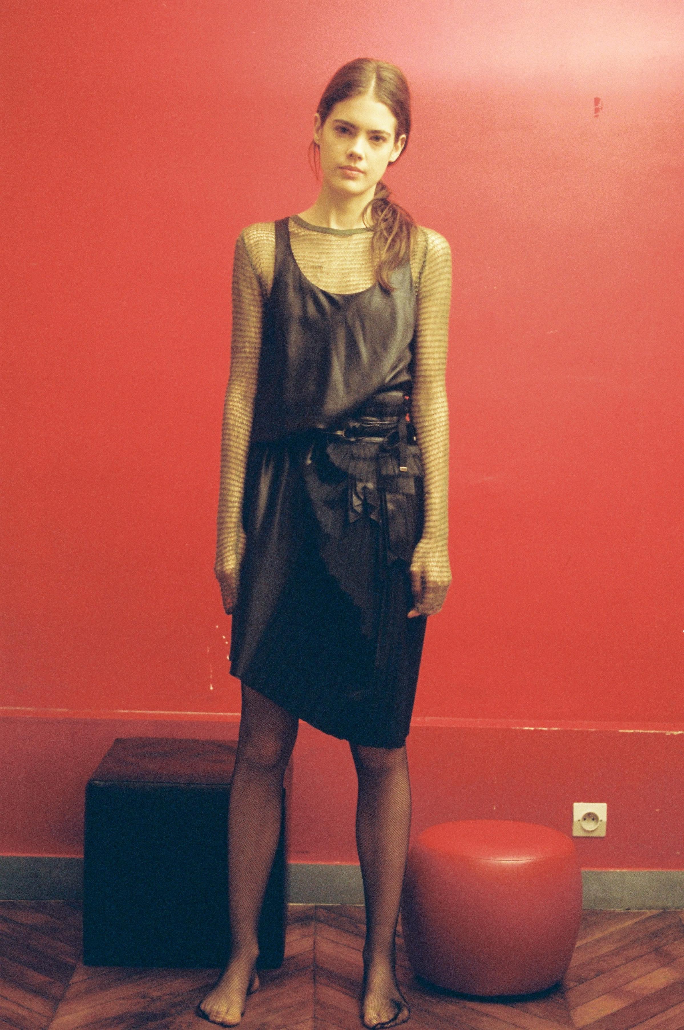 Silk black dress  VERONIQUE BRANQUINHO,  cashmere and silk fishnet top  JEAN COLONNA.