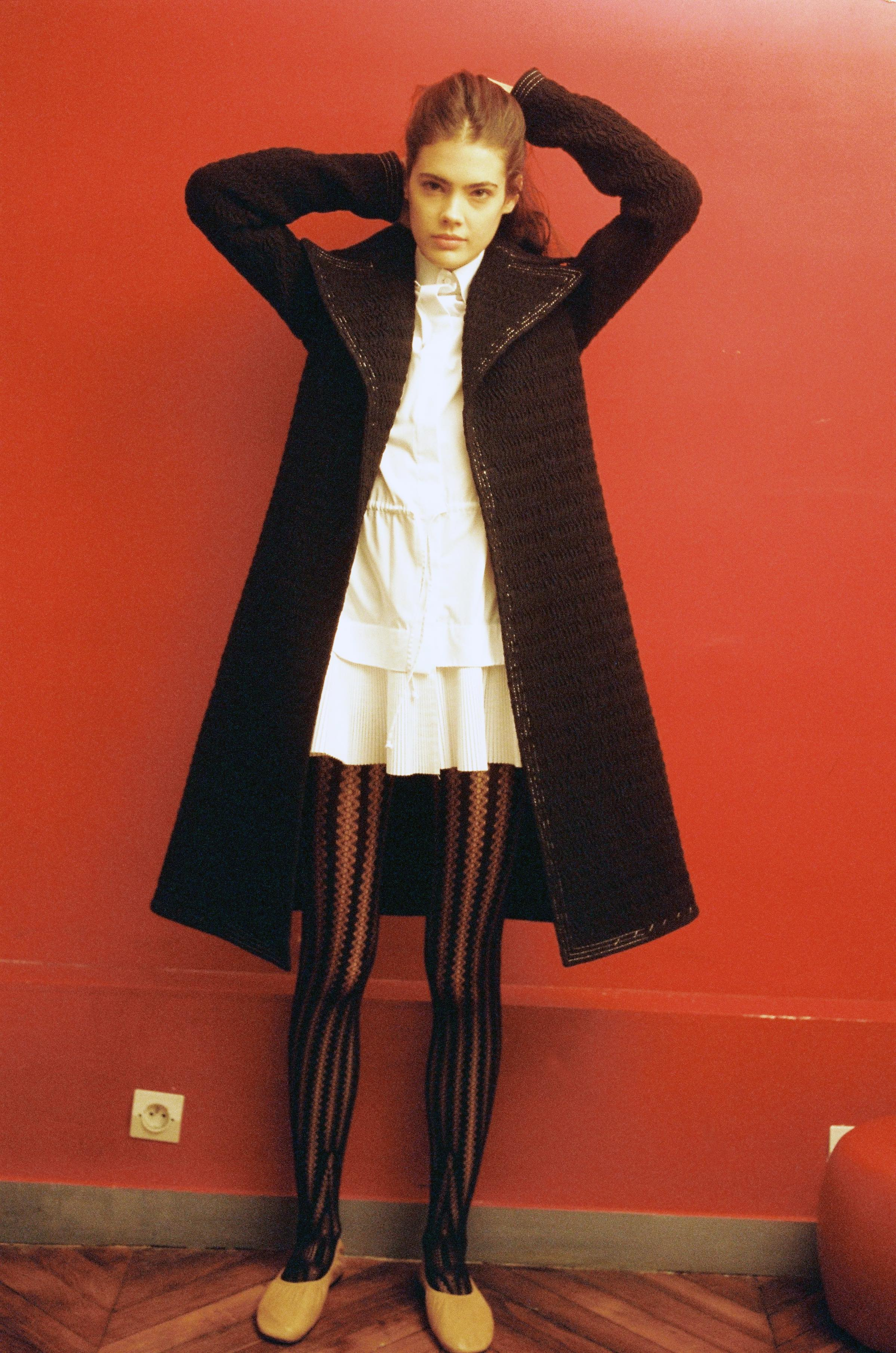 Smocked nylon coat  CÉLINE,  woven cotton pleated chemisier  ALAÏA,  tights  WOLFORD,  lambksin ballerinas  CÉLINE.