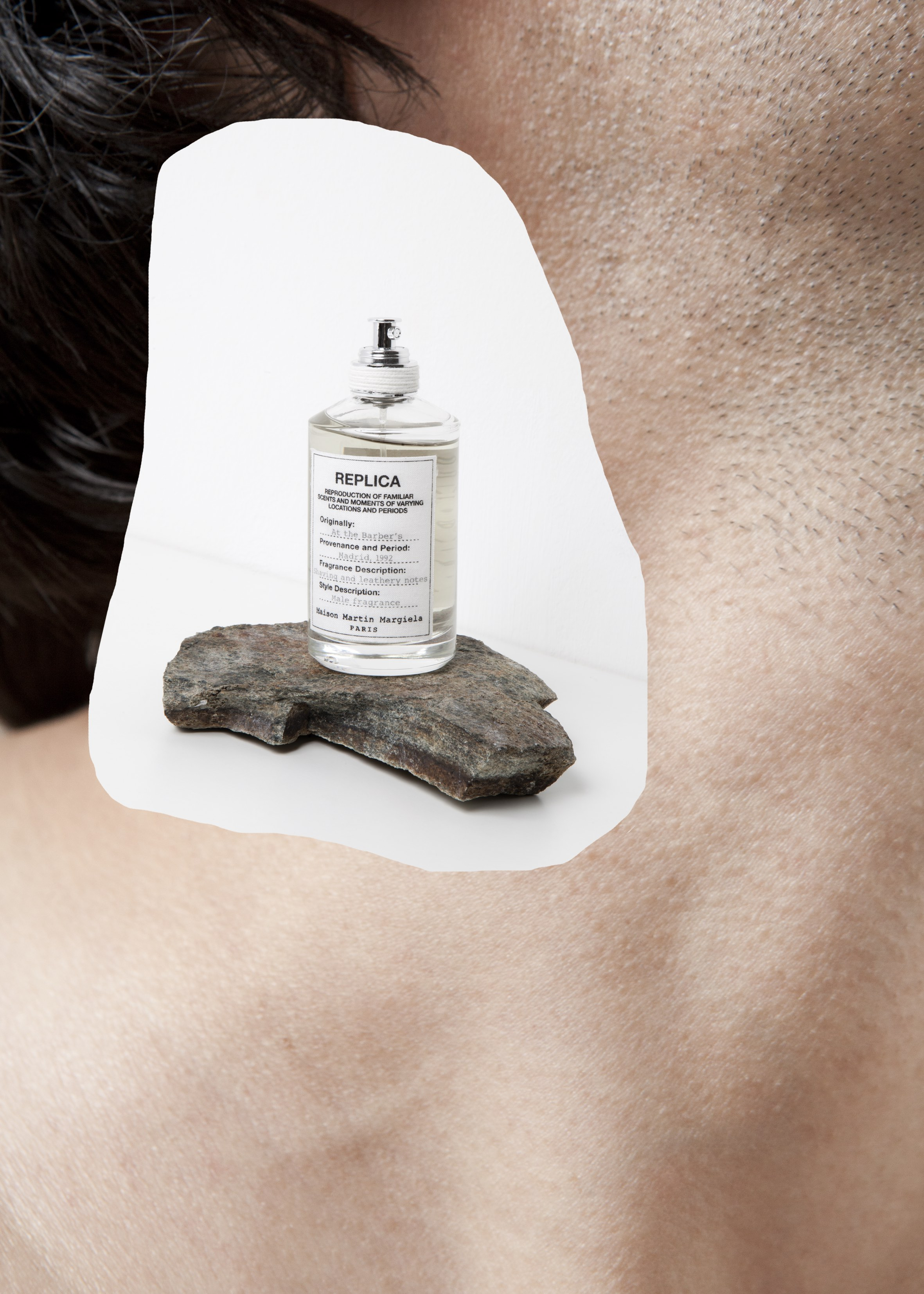 MAISON MARTIN MARGIELA AT THE BARBER'S  evokes a vintage masculine ritual in the atmosphere of a barbershop.