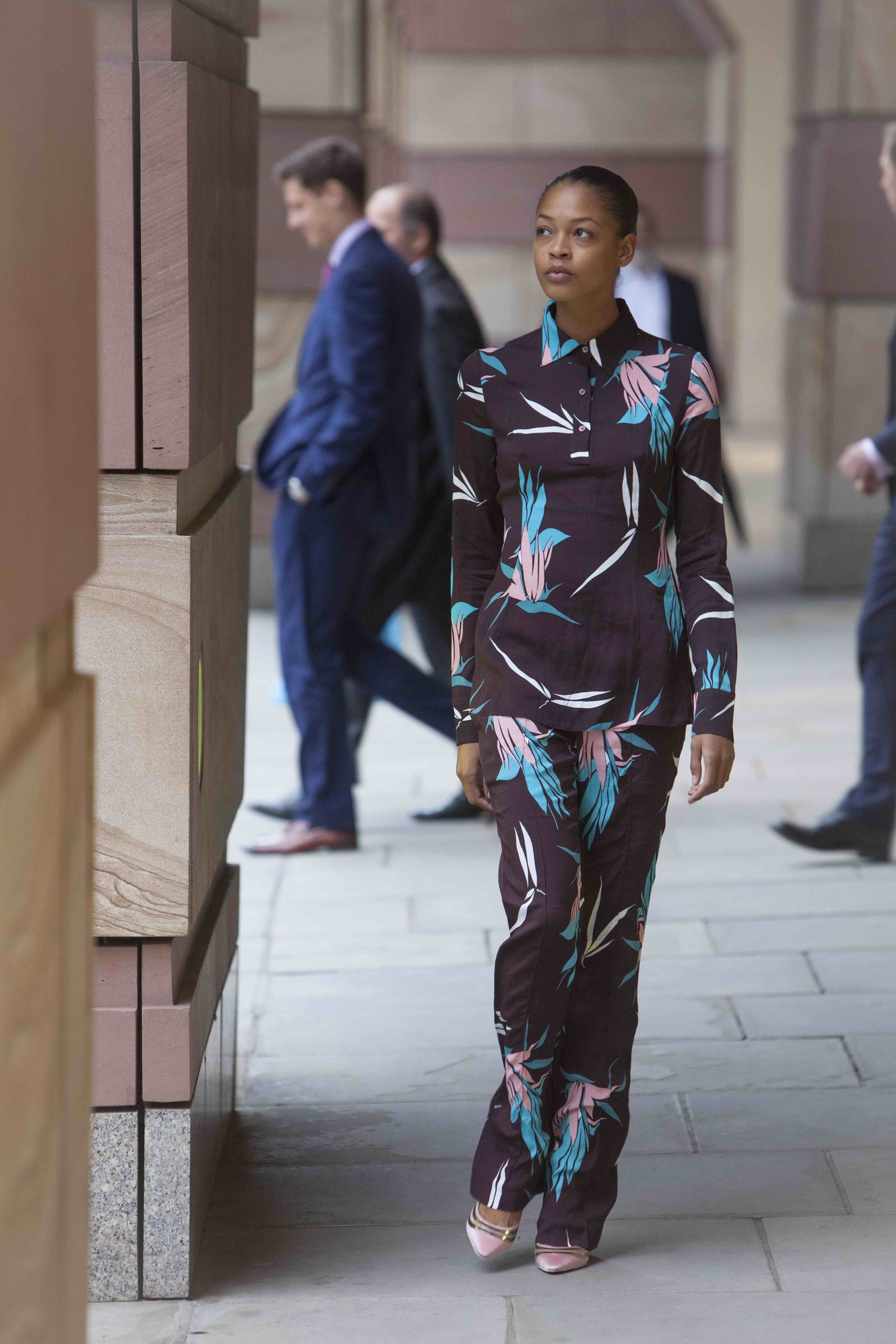 Printed top and trousers  MARNI , satin pumps  LOUIS VUITTON .