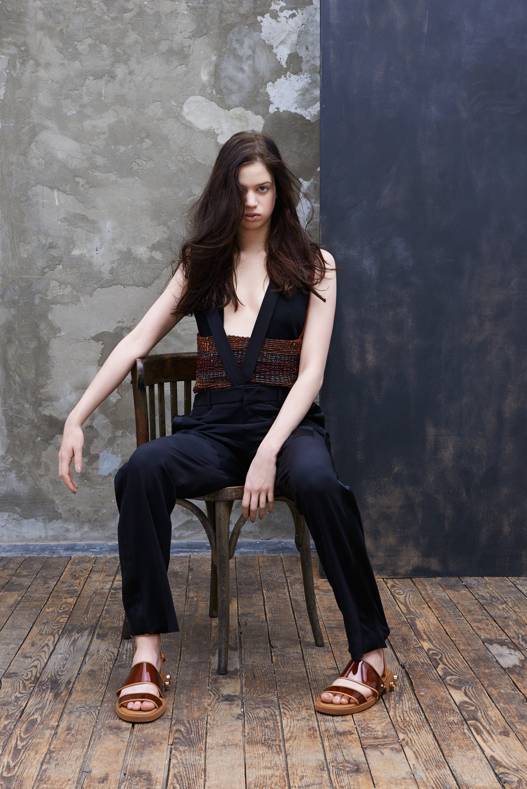 Knit body with copper sequined bustie, moroccon crepe trousers with suspenders and plastic sandals  GIVENCHY BY RICARDO TISCI , ophydienne ring in white gold fully set with diamonds  REPOSSI .
