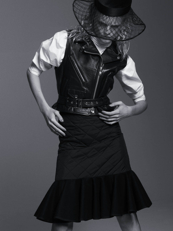 Black leather sleeveless biker jacket and diamond-pattern quilted godet skirt with wool flare bottom  SACAI , long-sleeved shirt  HACHE , hat  NEW YORK VINTAGE .