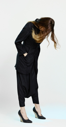 Pinstriped wool jacket with zip detail, matching drop crotch pants and leather pointed toe pumps  KTZ , Swarovski and silver clock earrings  MAK JEWELS .