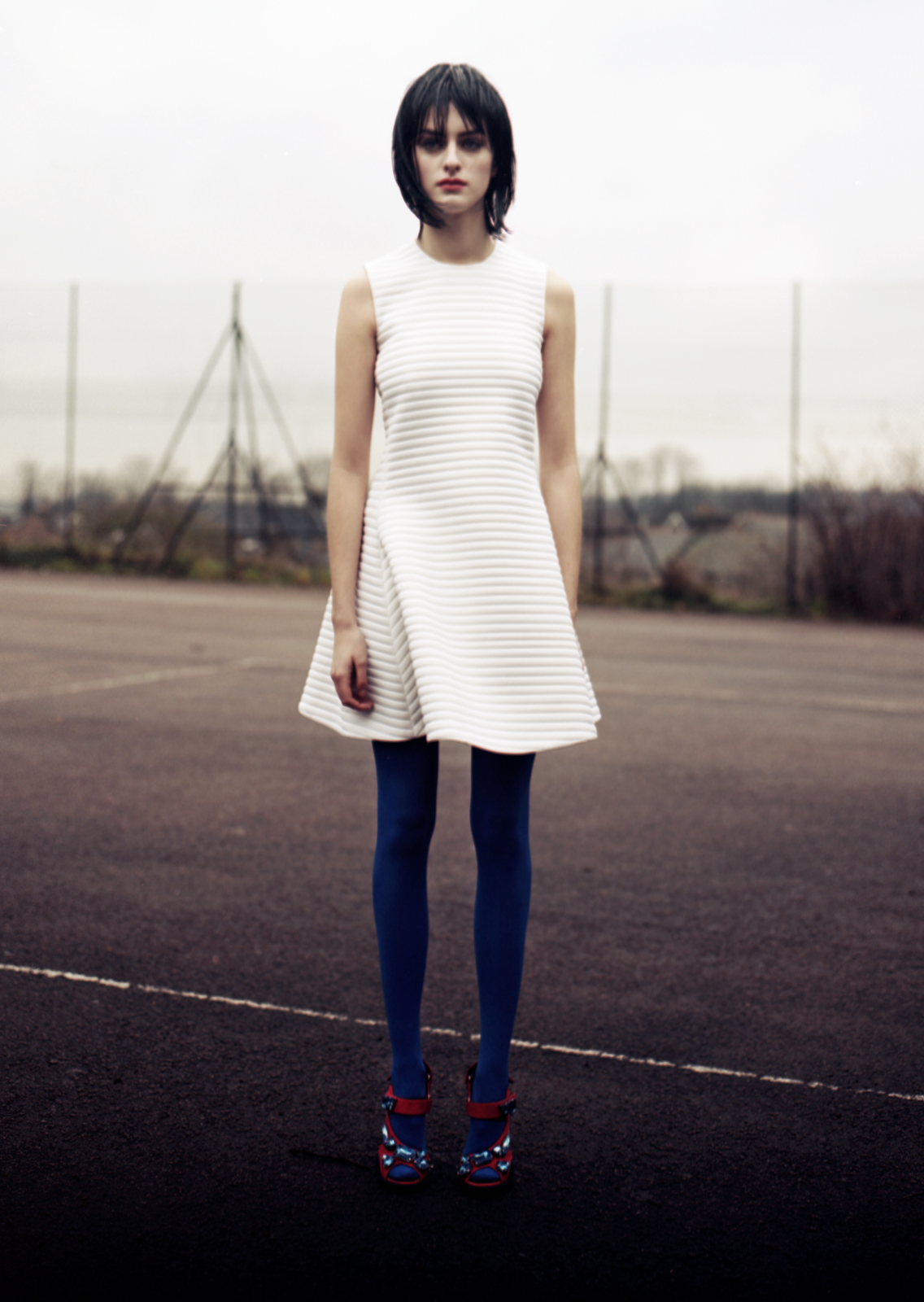 Flared rib jersey scuba dress by  NEIL BARRETT , jeweled suede sandals by  PRADA , blue tights stylist's own.