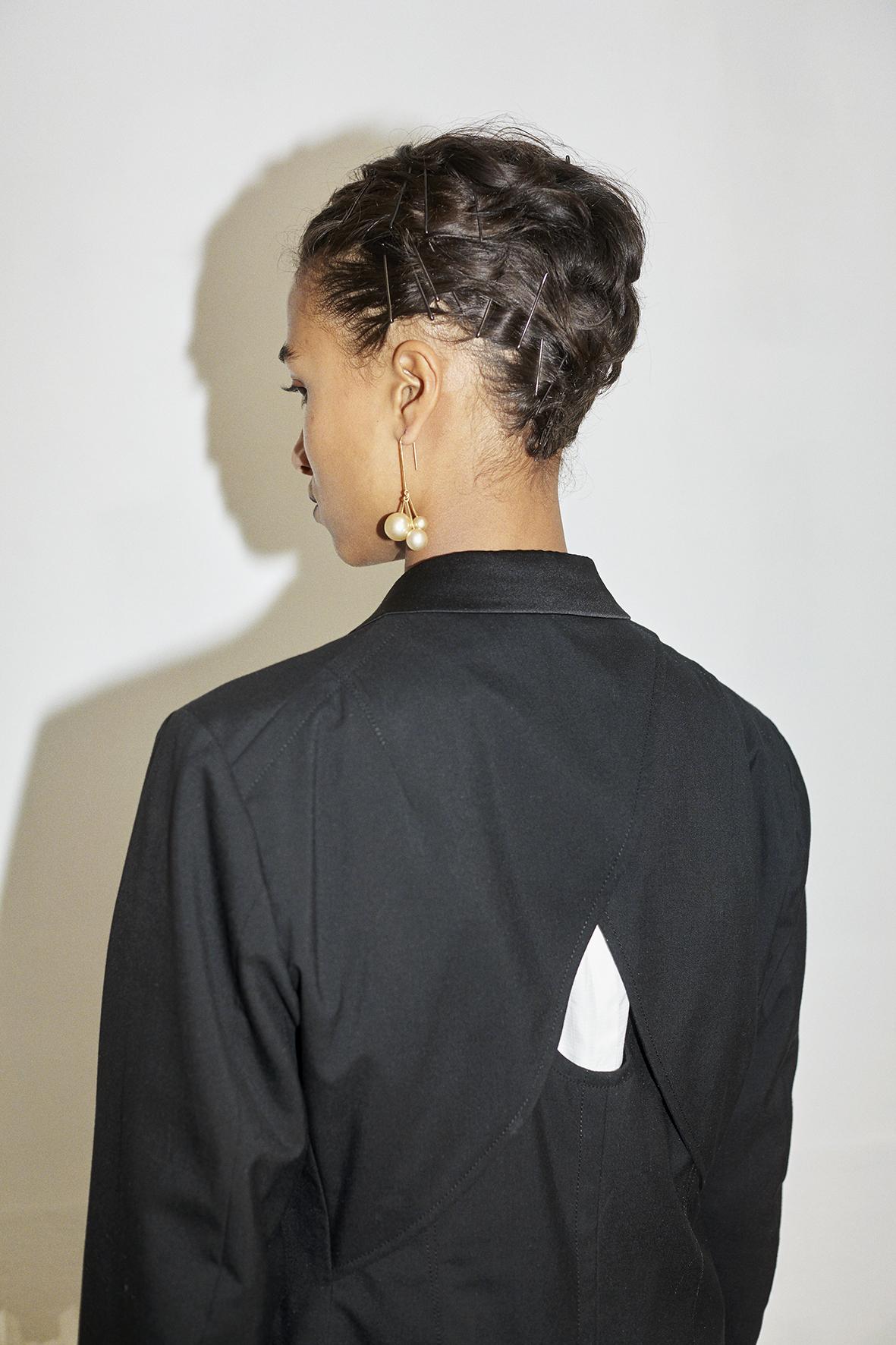 Tailored wool jacket. Ivory gold pearl earrings CÉLINE