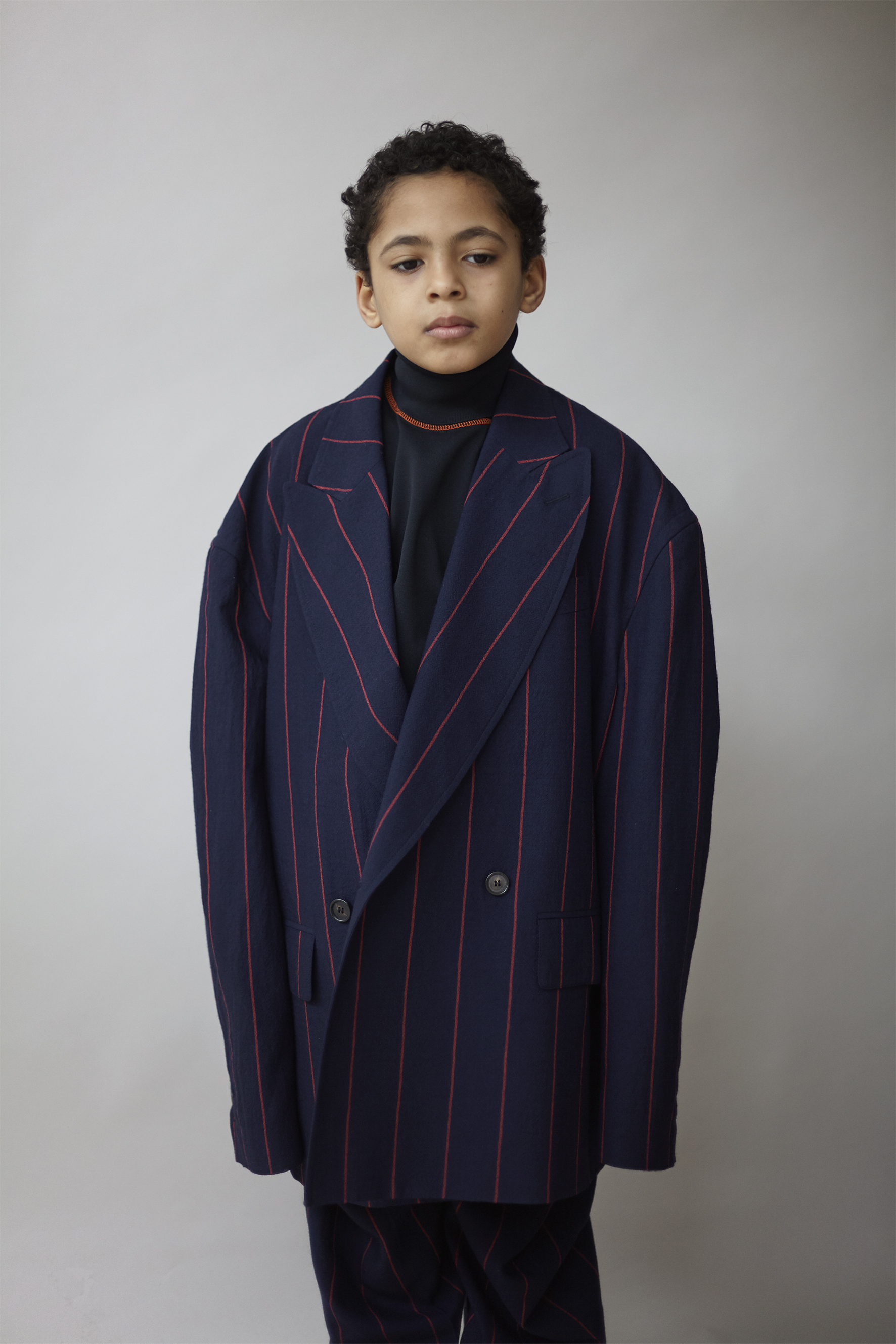 Pinstriped wool double breasted jacket ANDREAS KRONTHALER FOR VIVIENNE WESTWOOD,black technical jersey turtleneck PRADA.