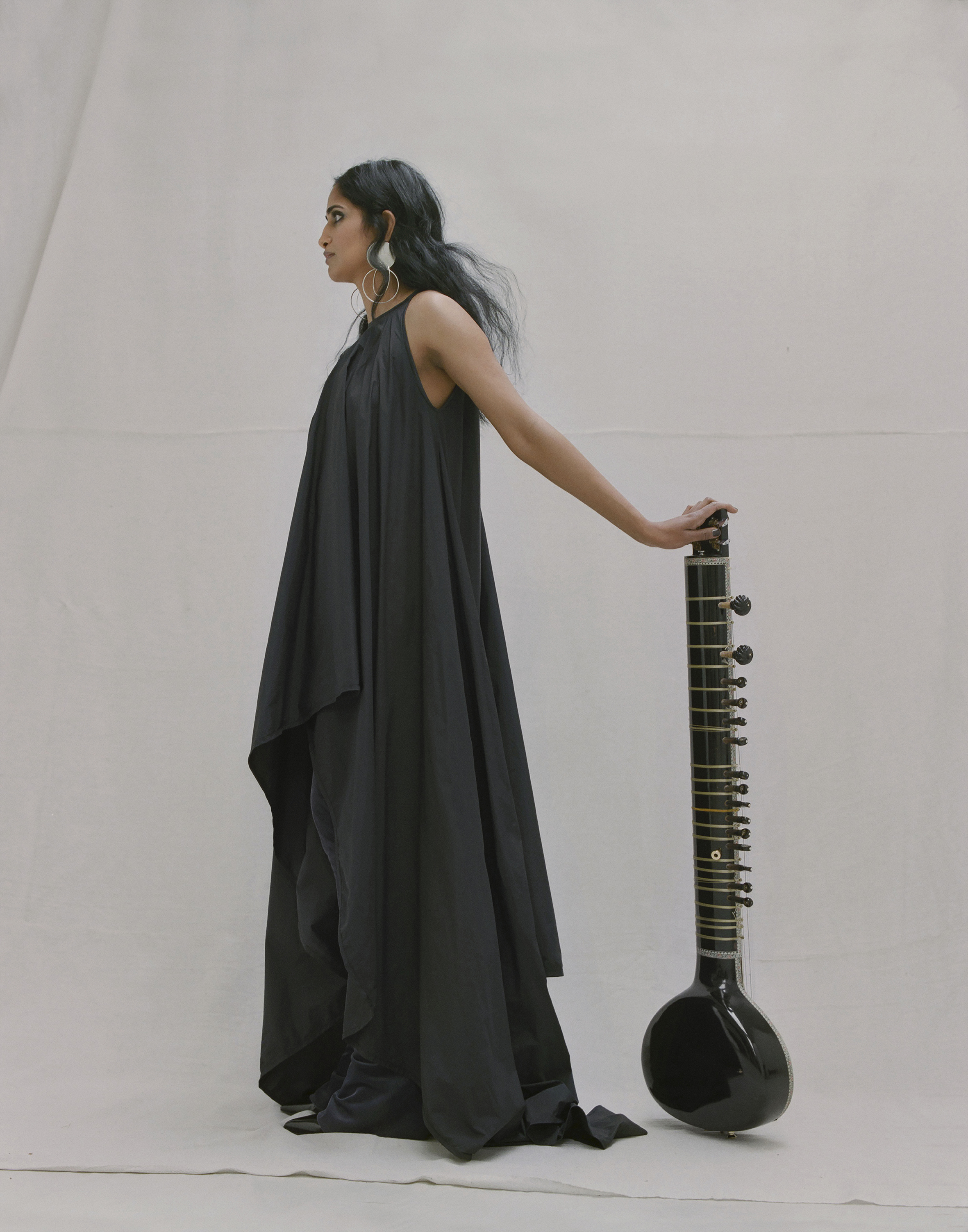 Asymmetrical long dress and trousers MICHAEL OLESTAD,black leather shoes PACO RABANNE,earrings ANNIE COSTELLO BROWN.