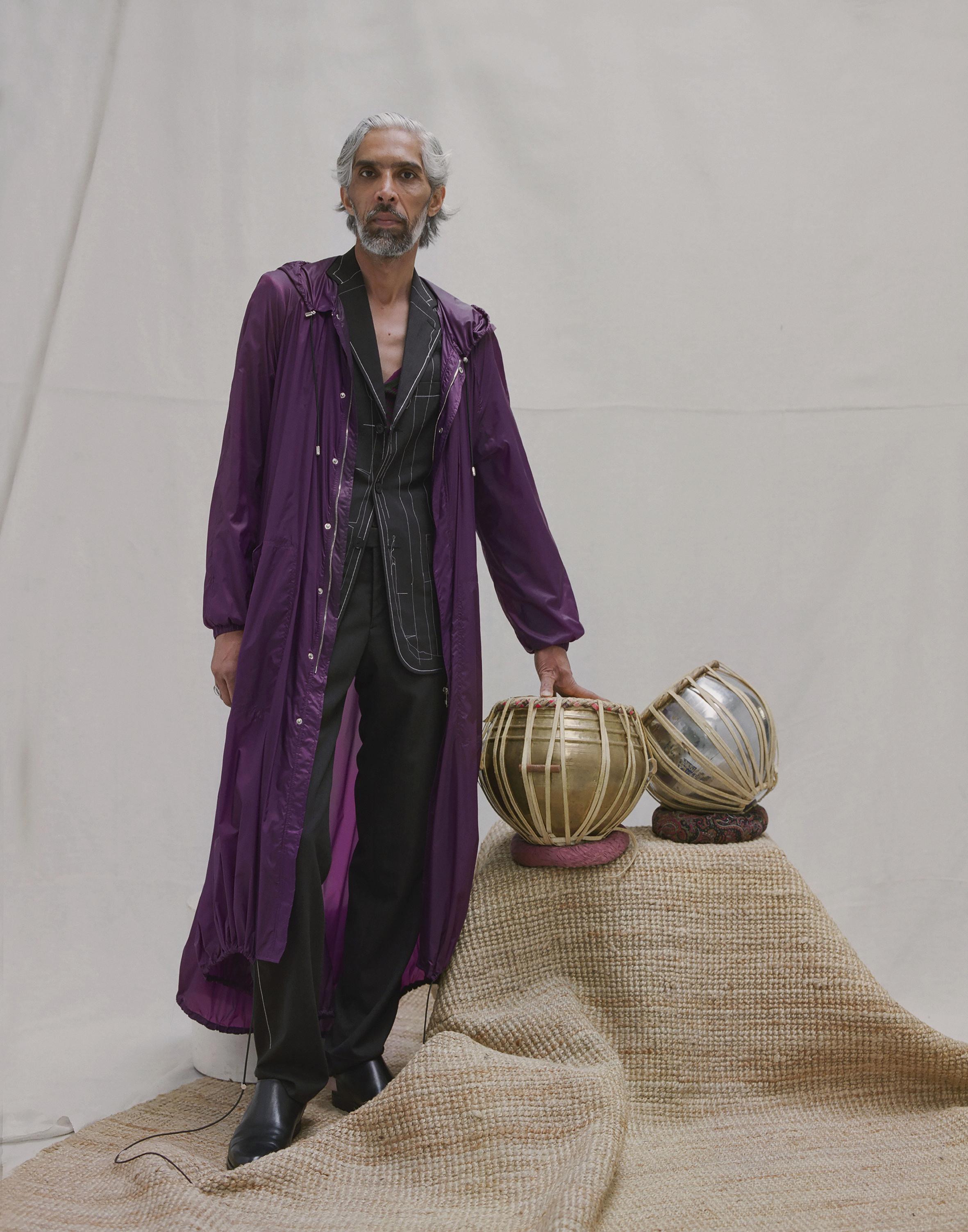 Outside stitched wool blazer and trousers MAISON MARGIELA,light nylon technical parka VERSACE.