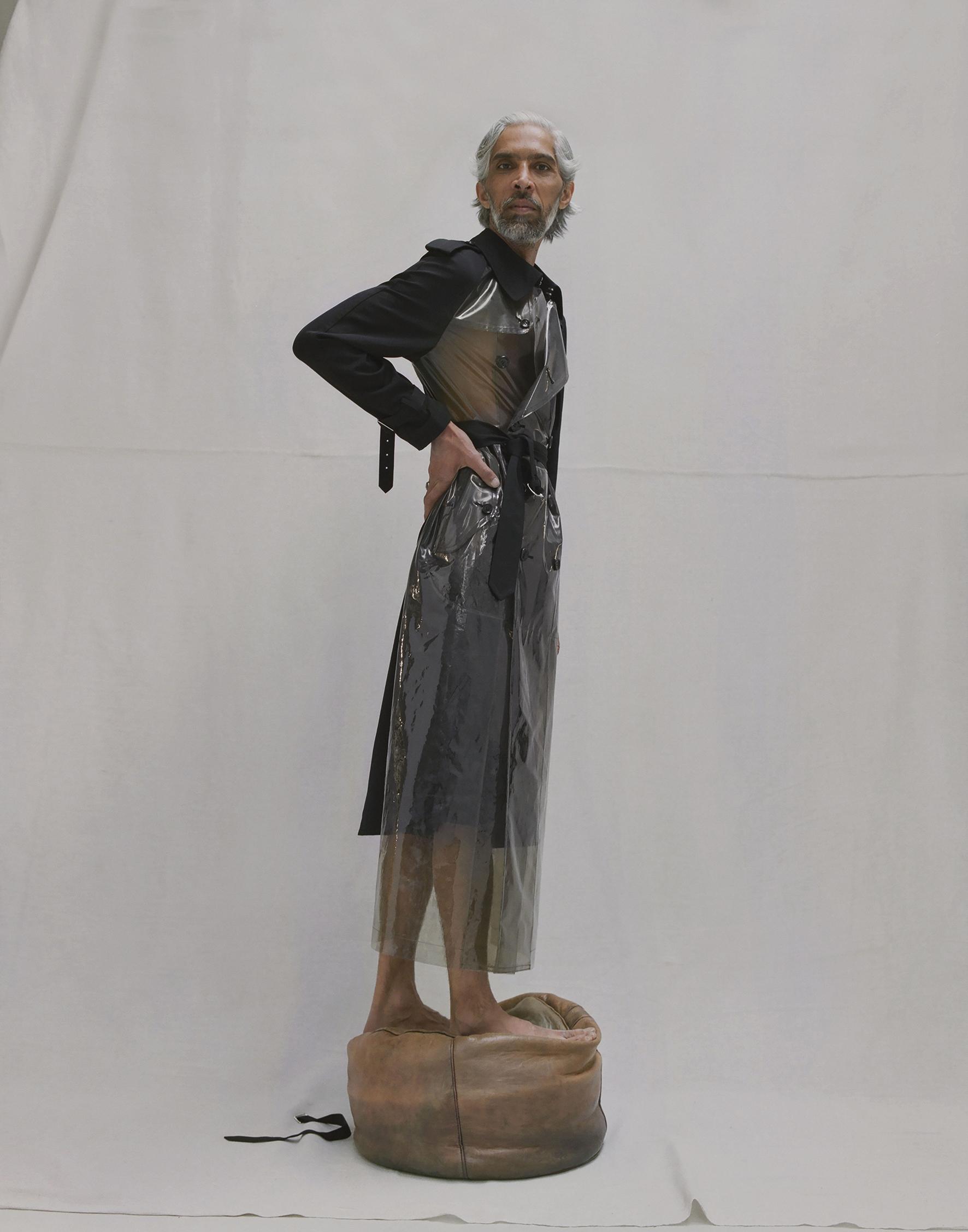 Transparent trench coat and gabardine trousers COMME DES GARÇONS.