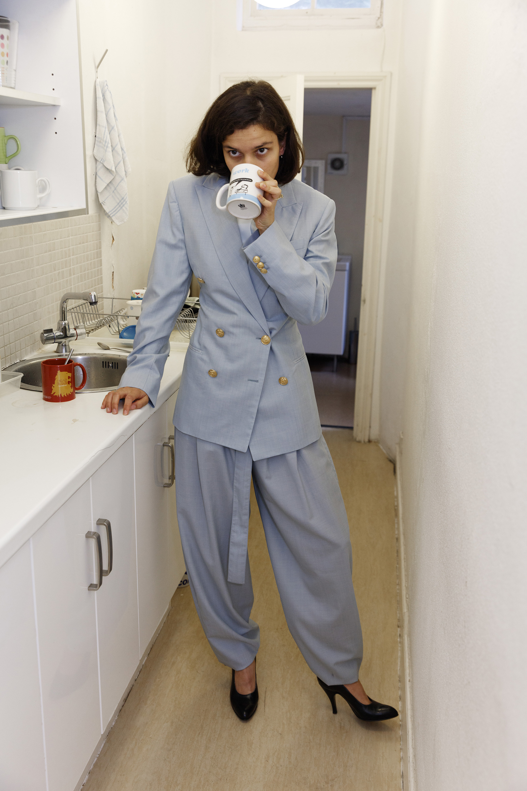 Double breasted jacket, soft wool high waisted belted trousers and interlock jersey oversize shirt CÉLINE, vintage pumps FRANCO JACASSI VINTAGE DELIRIUM