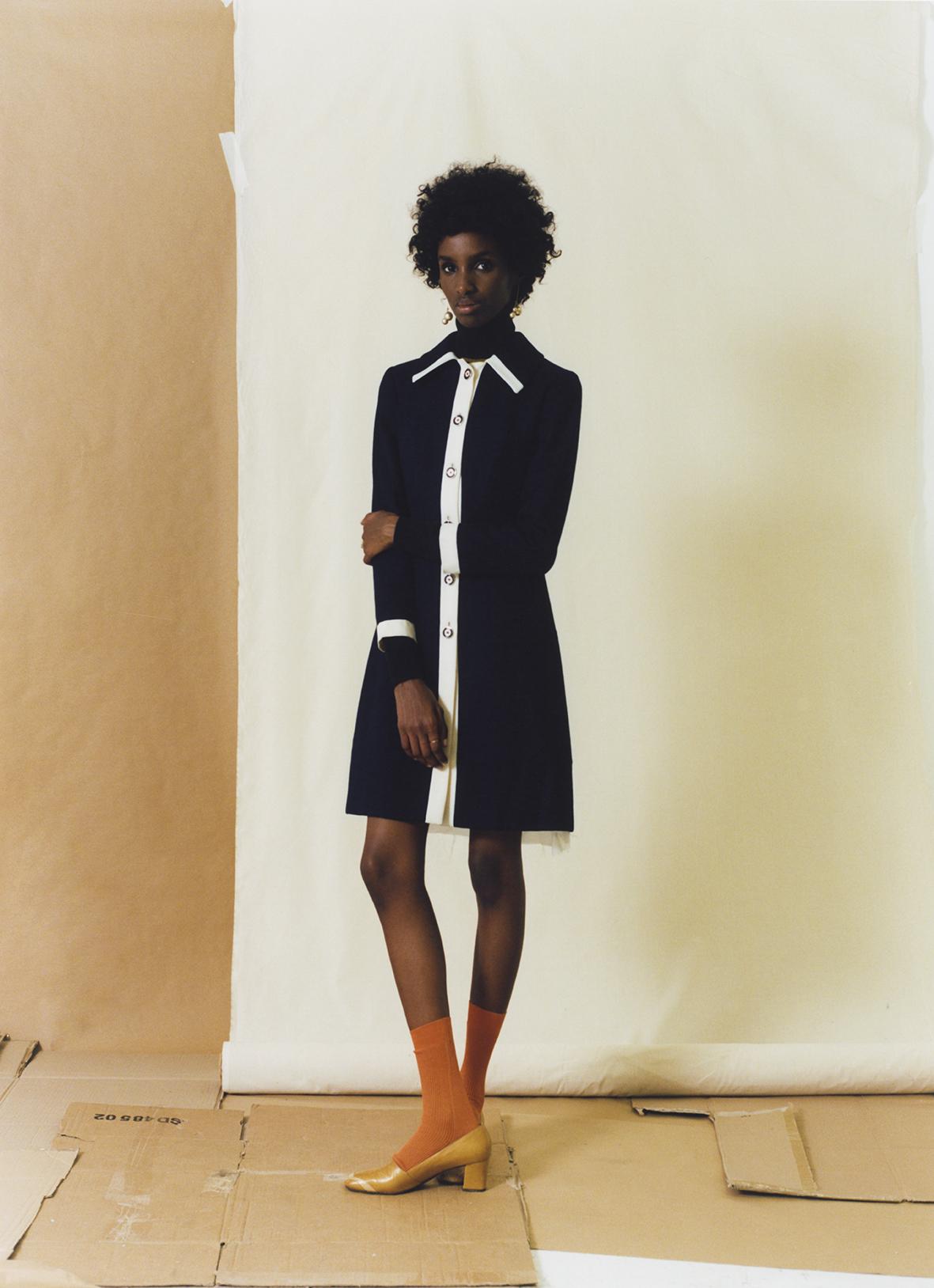 1969 wool gabardine bicolor dress FRANCO JACASSI VINTAGE DELIRIUM, stitched turtleneck PRADA,silk socks MARIA LA ROSA,leather pumps FRANCO JACASSI VINTAGE DELIRIUM, ivory gold pearl earrings CÉLINE.