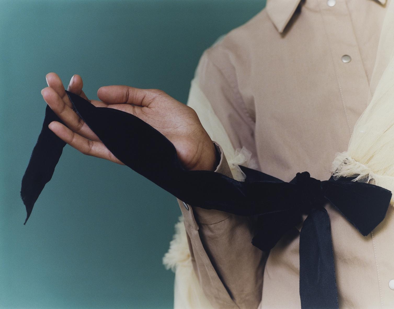 Camel gabardine chemisier BARBARA CASASOLA, tulle shawl with velvet ribbon MOLLY GODDARD.