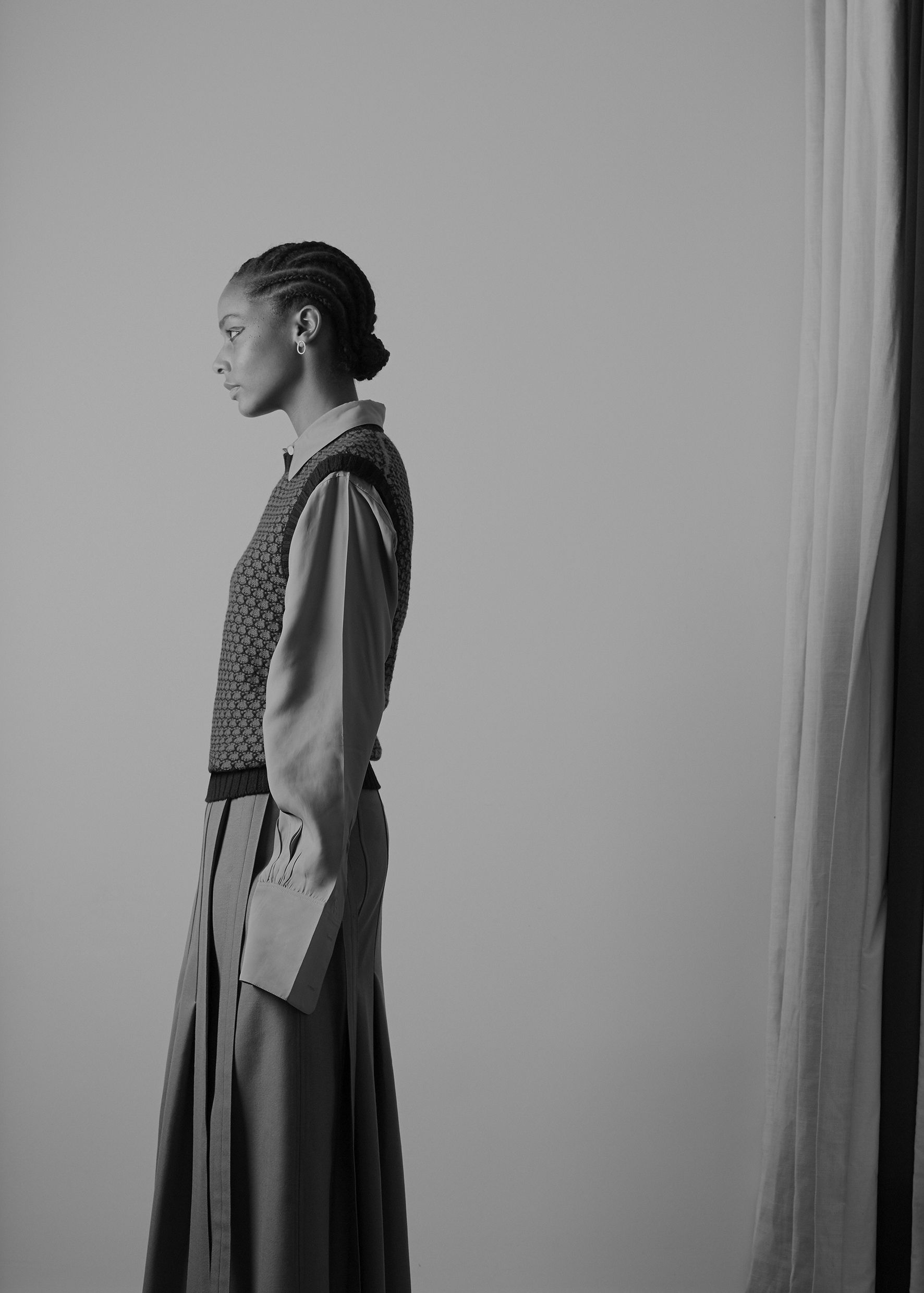 Viscose twill oversize shirt and long wrap wool blend skirt CÉLINE, honeycomb sleeveless jumper HOLLAND & HOLLAND,  golden earring COMPLETEDWORKS.