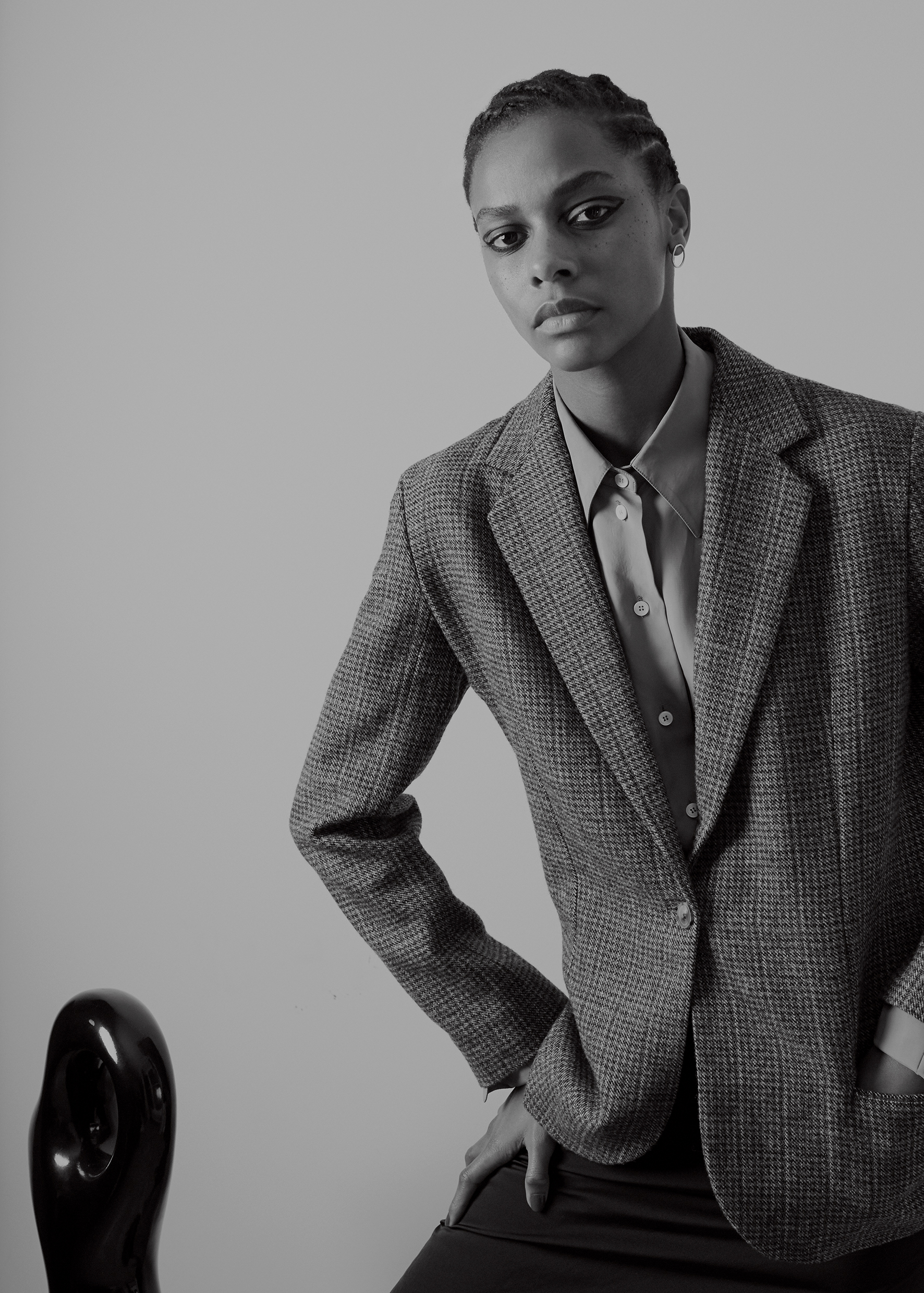 Oversize twill shirt CÉLINE, wool tweed checkered jacket HOLLAND & HOLLAND, golden earring COMPLETEDWORKS.