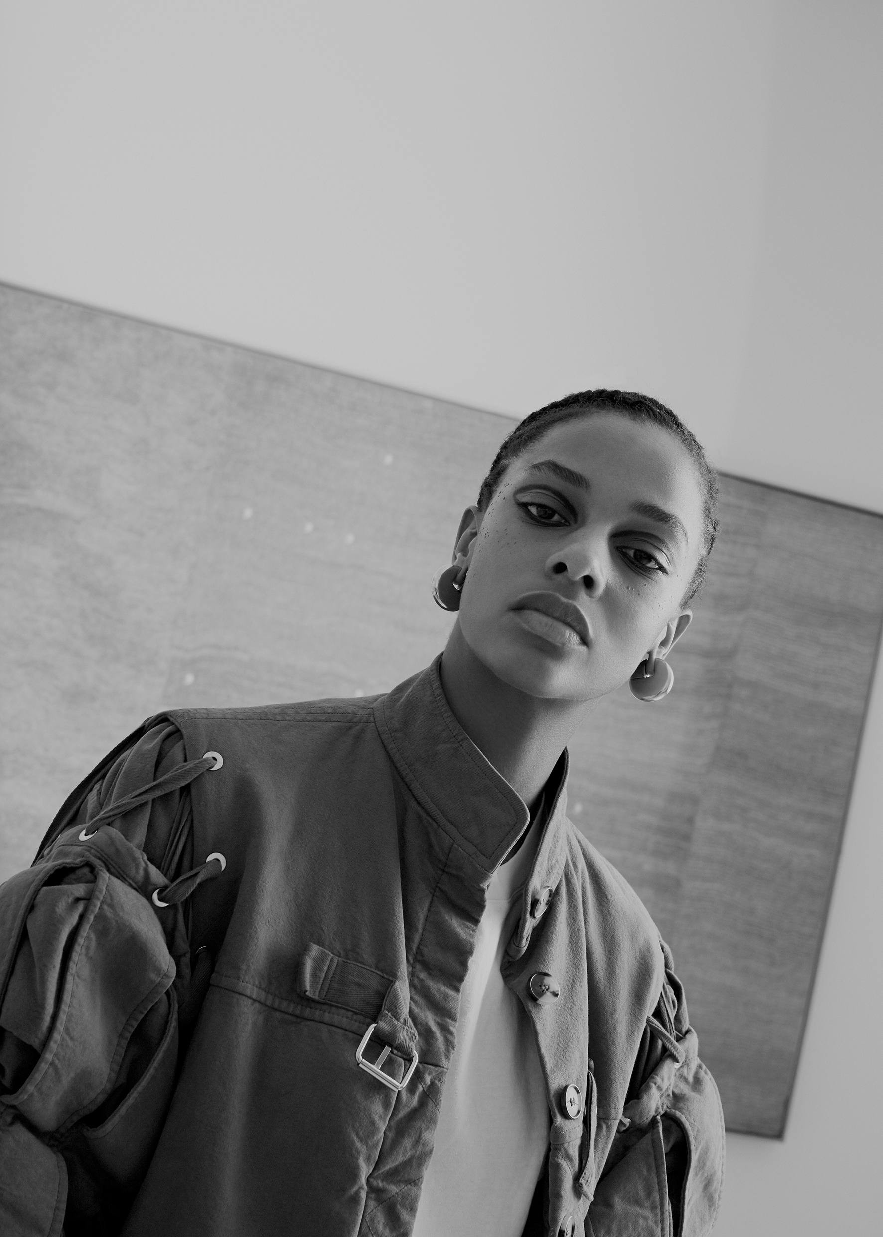 Buckled quilted jacket J.W. ANDERSON, white t-shirt DRIES VAN NOTEN, silver brass earrings CÉLINE.