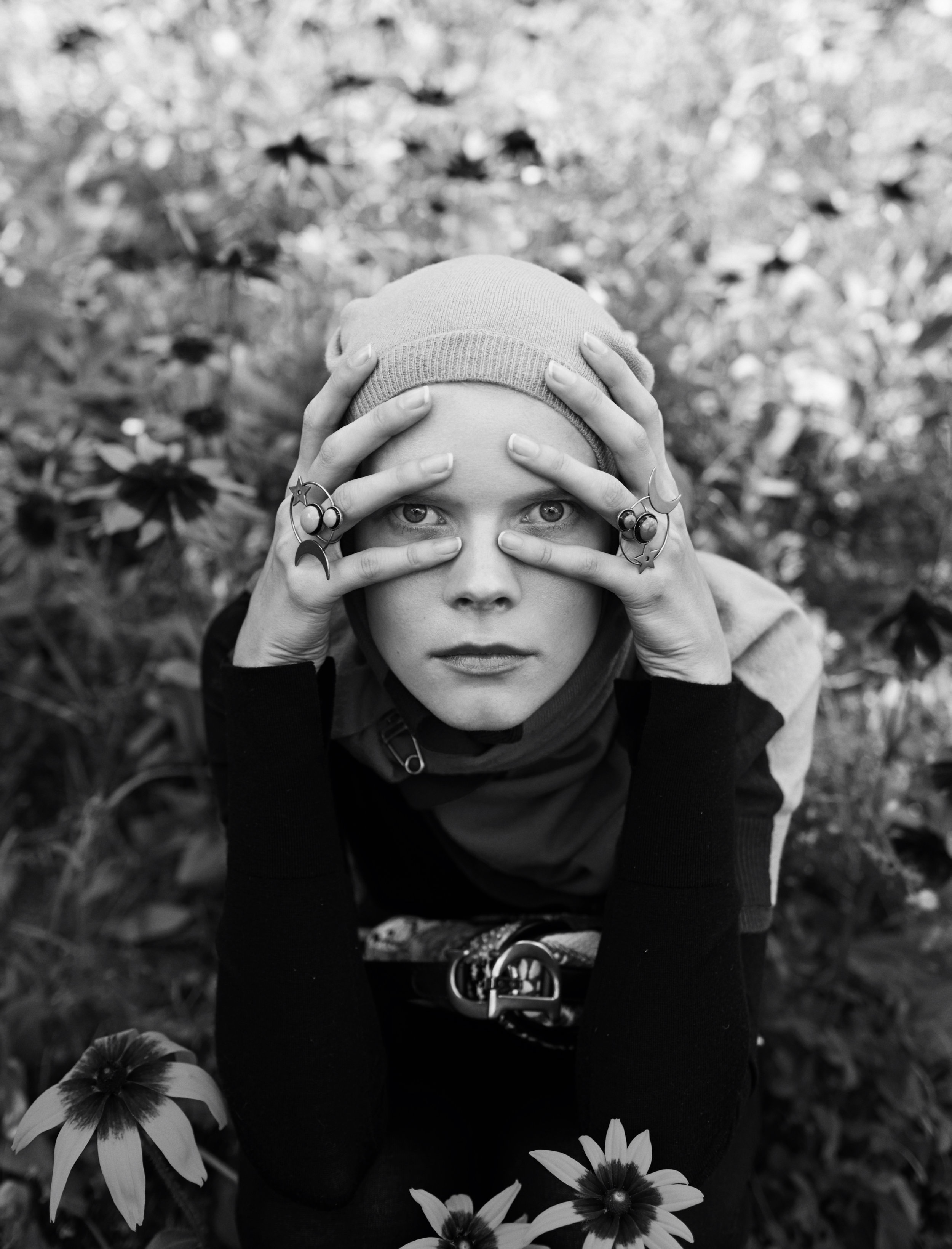 Cardigan as a headband Rochas, turtleneck Ambush, bag and rings Dior