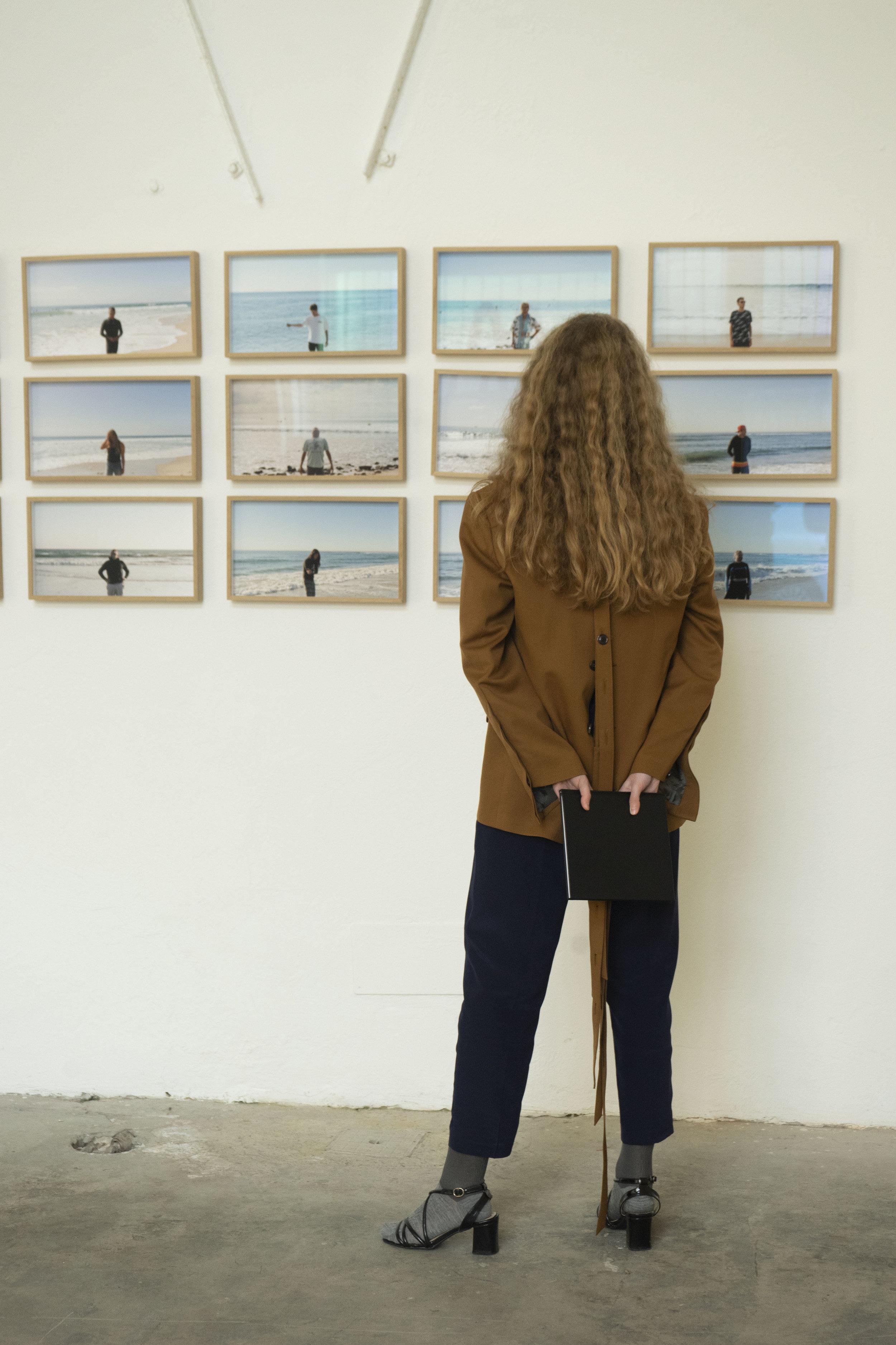 Wool blazer: Y Project, Silk trousers: Seventy, socks: Maria La Rosa, sandals: stylist own.    Art piece: Le origini dell' Universo  Artist: Roberto Fassone