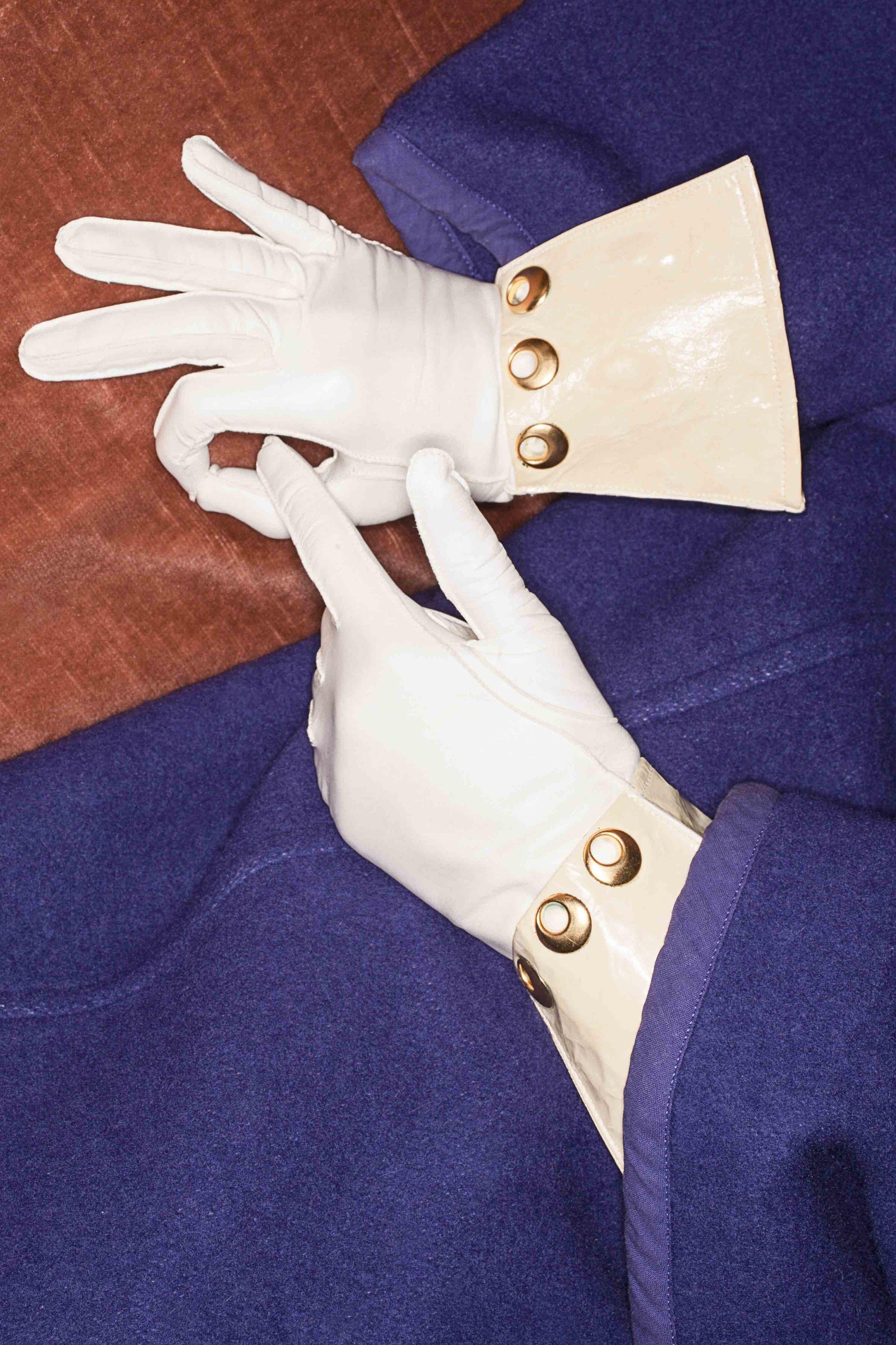 Gloves: Pusateri Firenze, coat: vintage  COMME des GARÇONS stylist own .