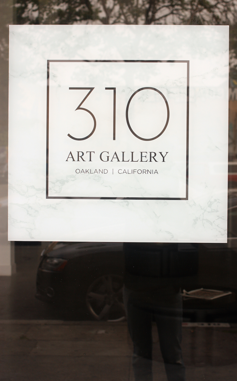 Outside window, gallery sign, and my boyfriend-fit jeans.