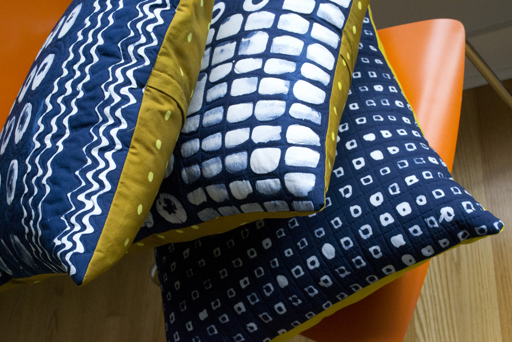 A stack of indigo dyed and patterned pillows, ready for their close-ups.