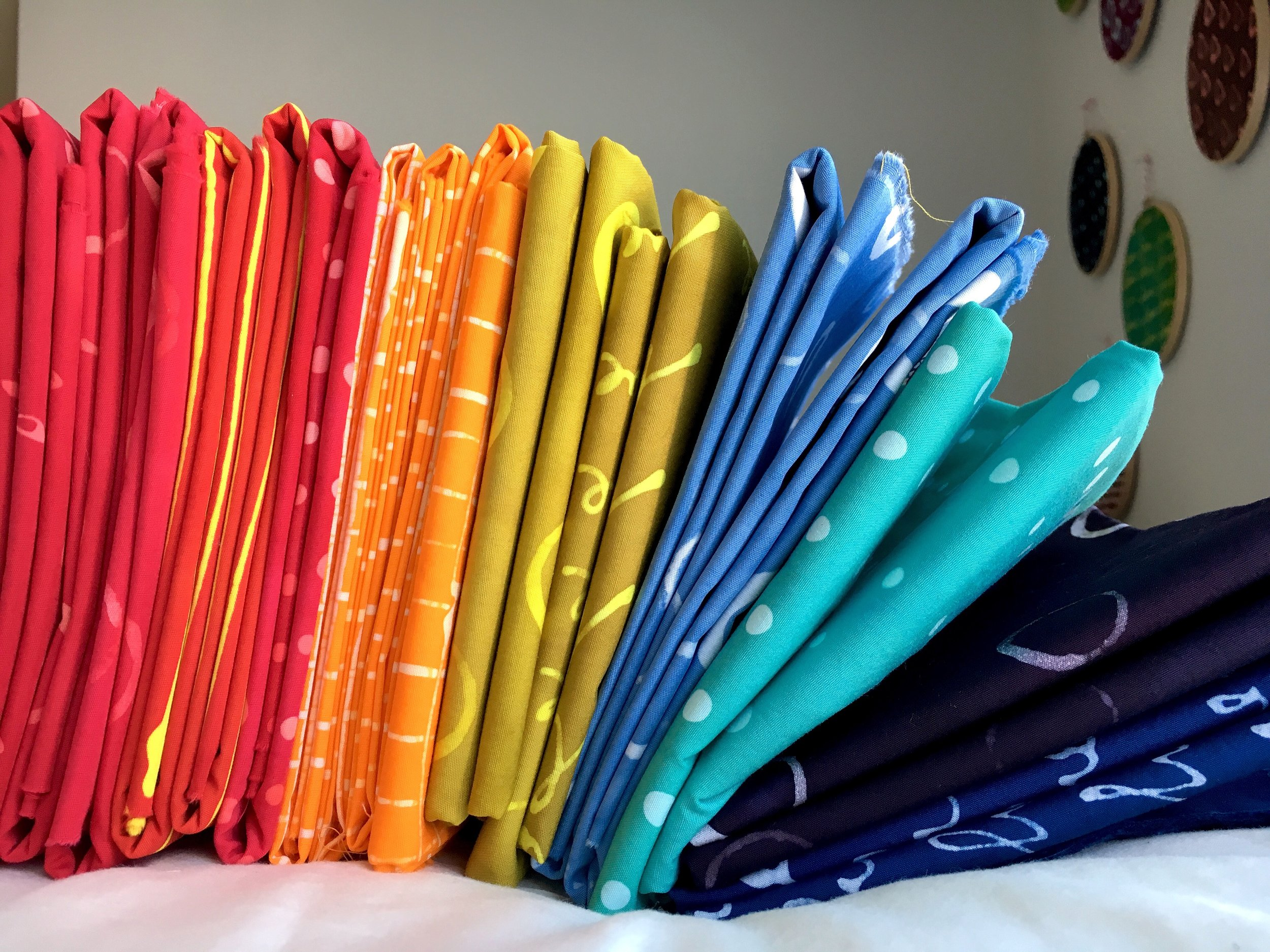 A rainbow of finished fabrics on their way to a new home.