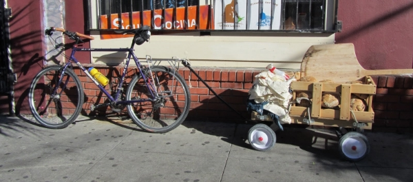 this is how i used to get my bread around town. and not just my bread - as you can see from the pile of stuff, i would also bring all of my bread making supplies with me. a bit of a gypsy baker if you will.