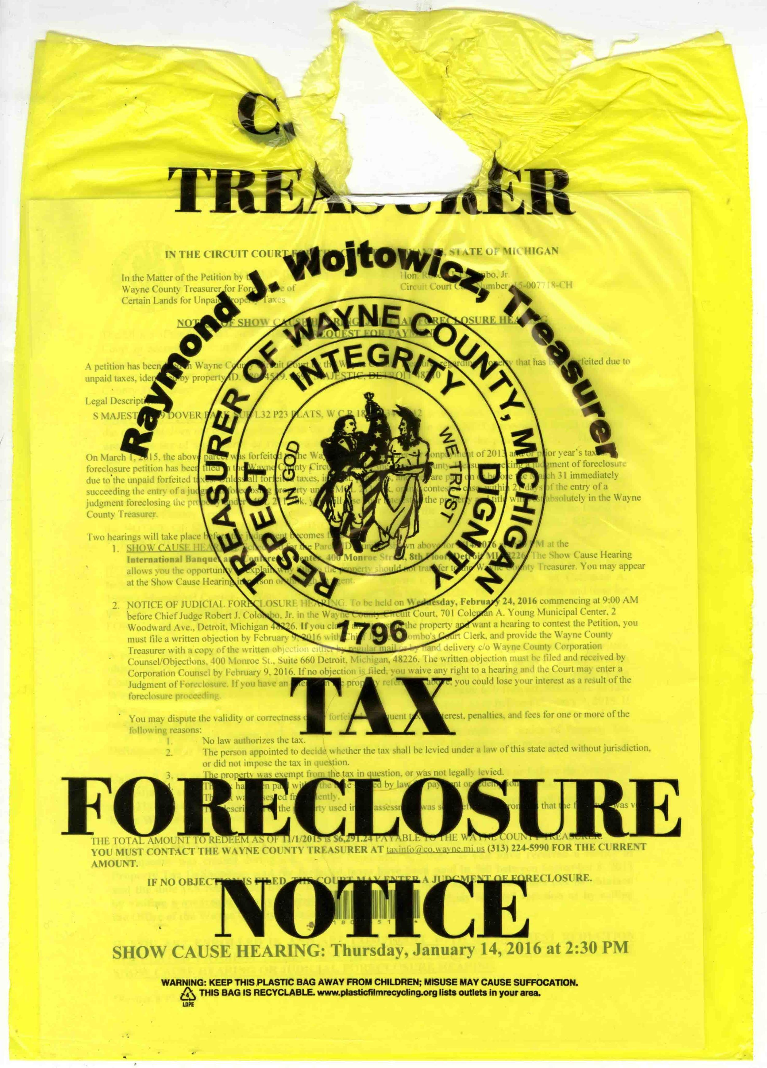 The yellow Foreclosure Notice bag is an unfortunate fixture throughout Detroit neighborhoods.